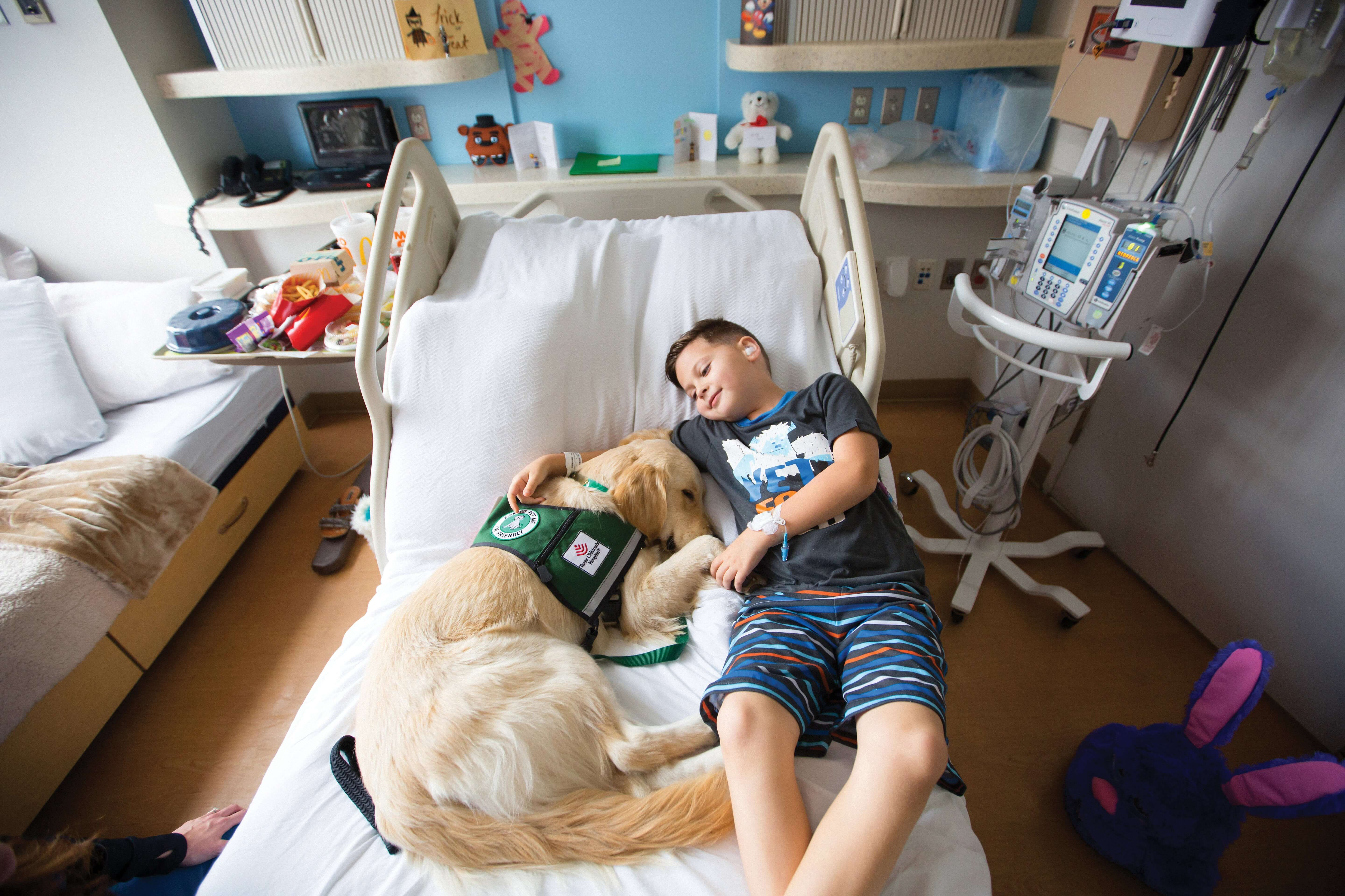 Brody Zacharias visits with Elsa in his room at Texas Children's Hospital.