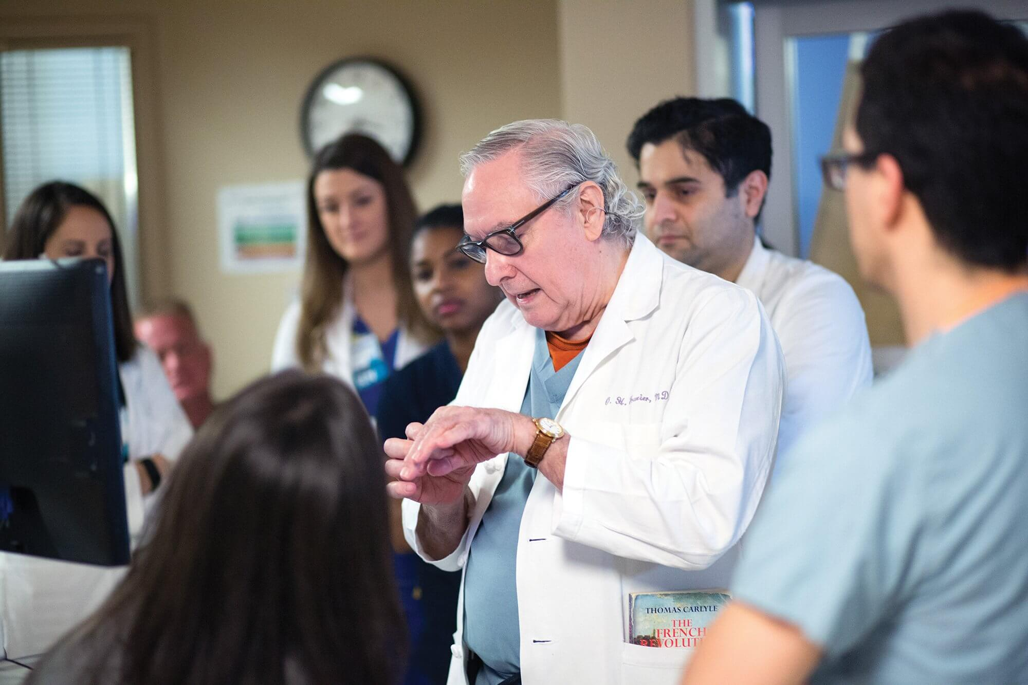 3:26 p.m.: Frazier demonstrates the way blood is pushed in and out of the heart after a left ventricular assist device (LVAD) is implanted.