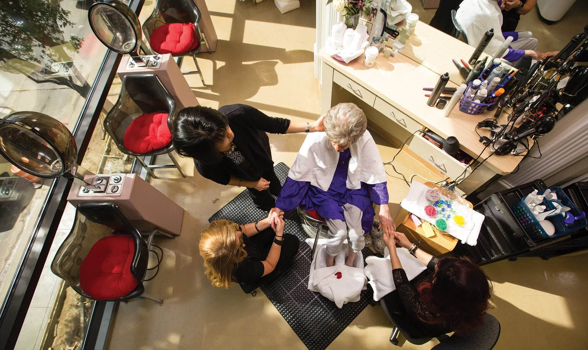 Stylists at Encore Hair Design & Boutique work with Houston Methodist patient Suzi Hayes.