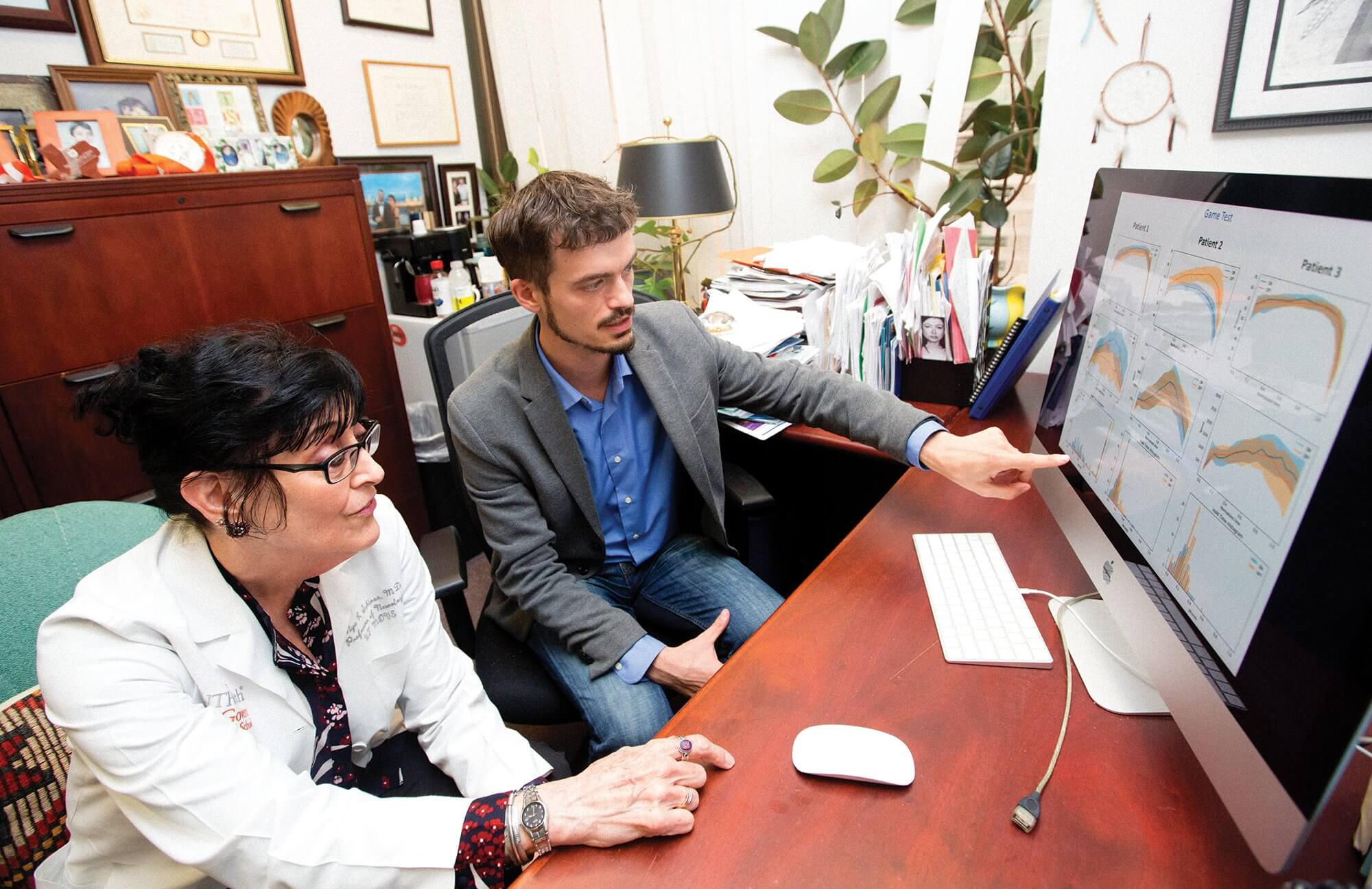 "Mya Schiess, M.D., left, is working with Luca Giancardo, Ph.D., on ""passive monitoring"" of keystrokes to help diagnose Parkinson's disease."