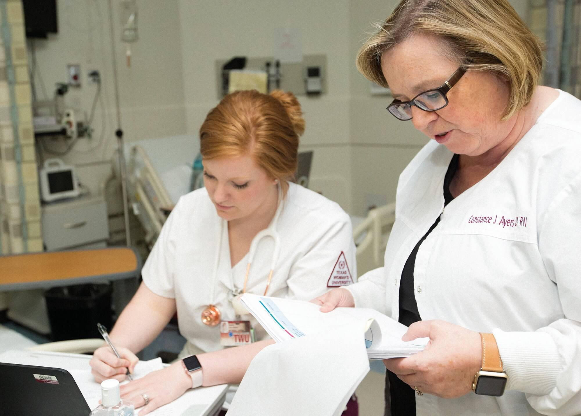 Connie Ayers, Ph.D., RN, who helped develop the program, consults with a student.