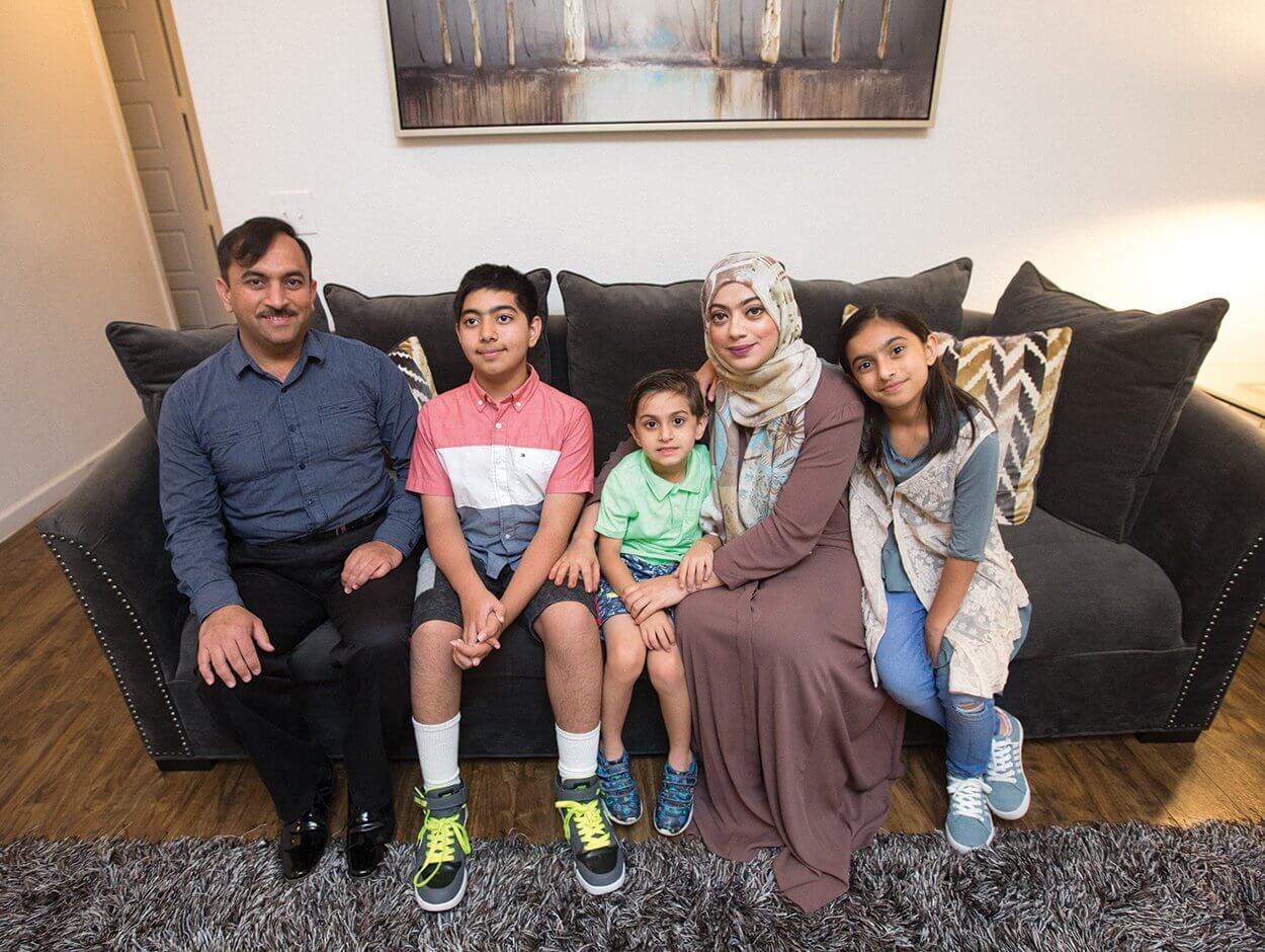 The Majeed family poses at home in Conroe, Texas, from left to right: Ashif, Umair, Ayan, Bushra and Sara.