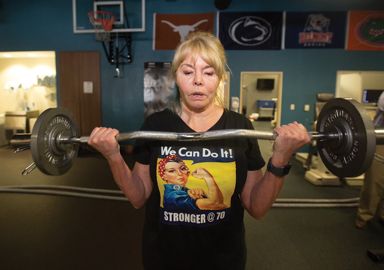 Jean Hoepfel, 70, performs bicep curls at the Memorial Hermann IRONMAN Sports Medicine Institute's Human Performance Lab.