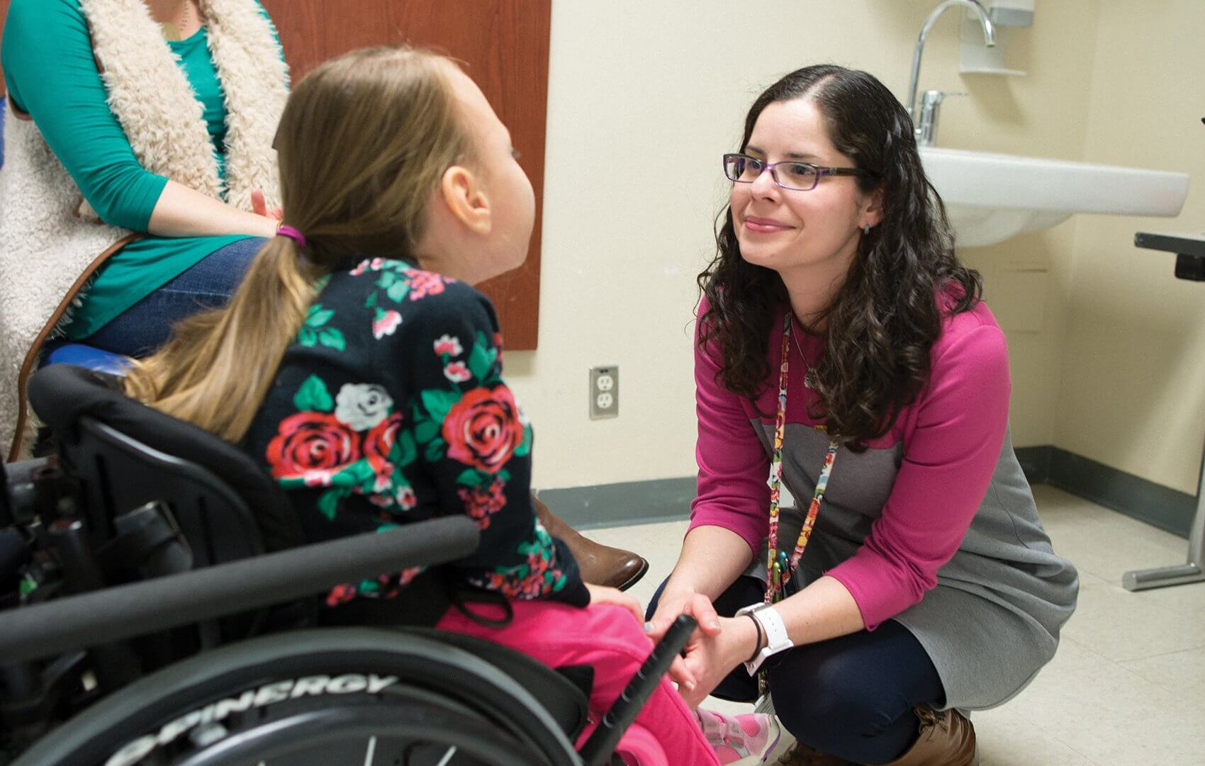 Glendaliz Bosques, M.D., works with one of her therapy patients at TIRR Memorial Hermann.