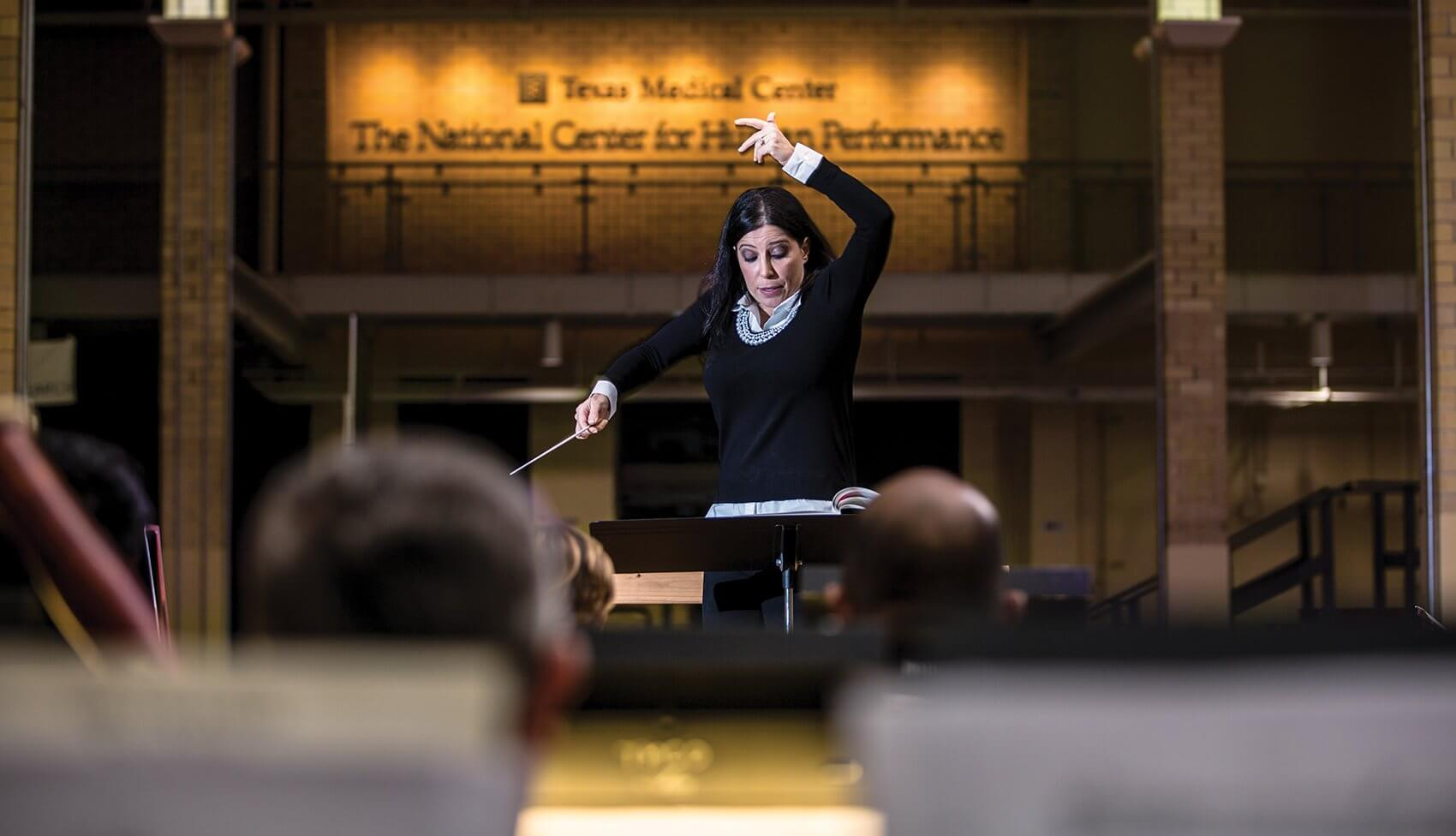 Libi Lebel founded the Texas Medical Center Orchestra and has been directing it ever since.