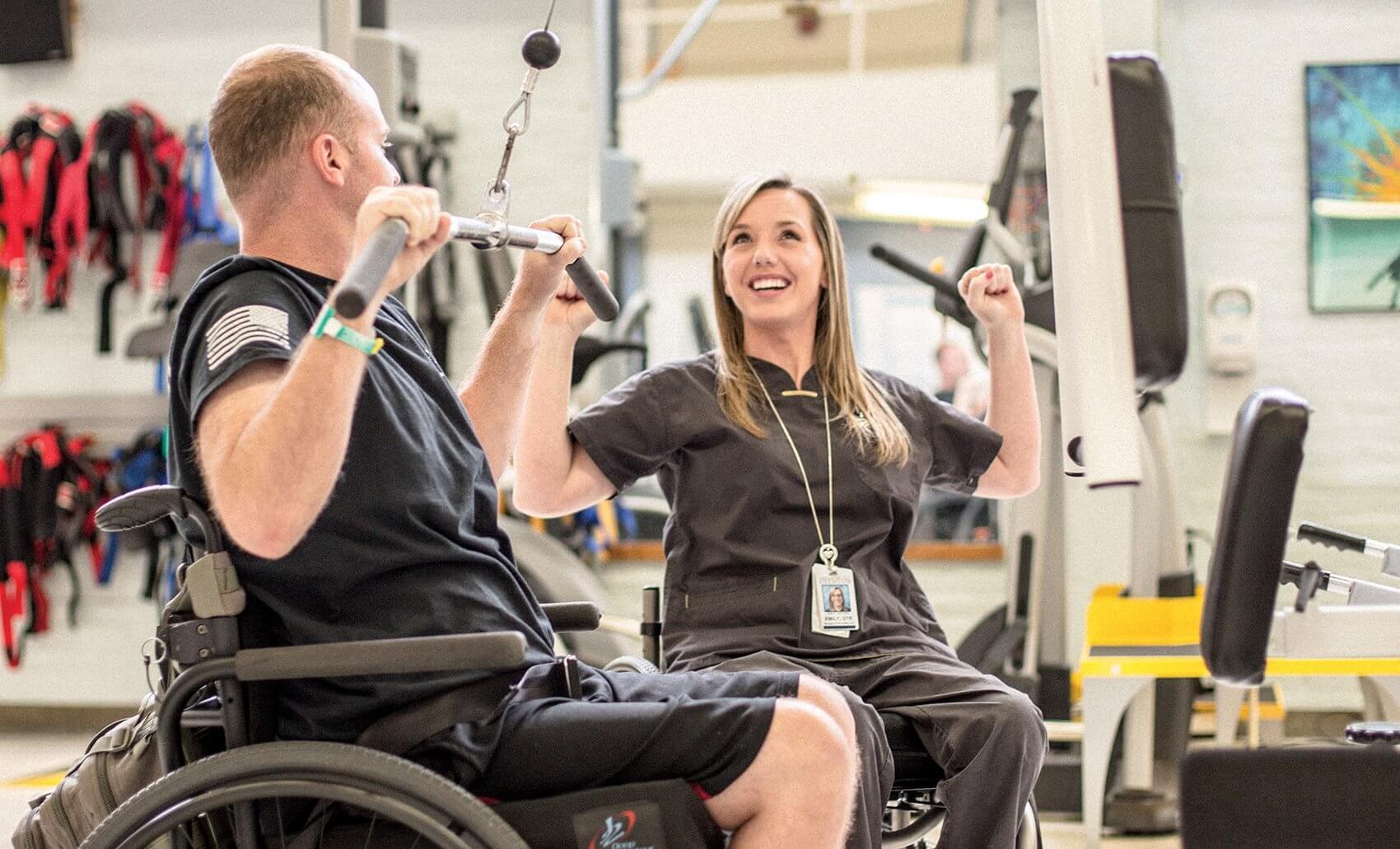 TIRR Memorial Hermann Occupational Therapist Emily Potter assists patient Michael Bullitt.