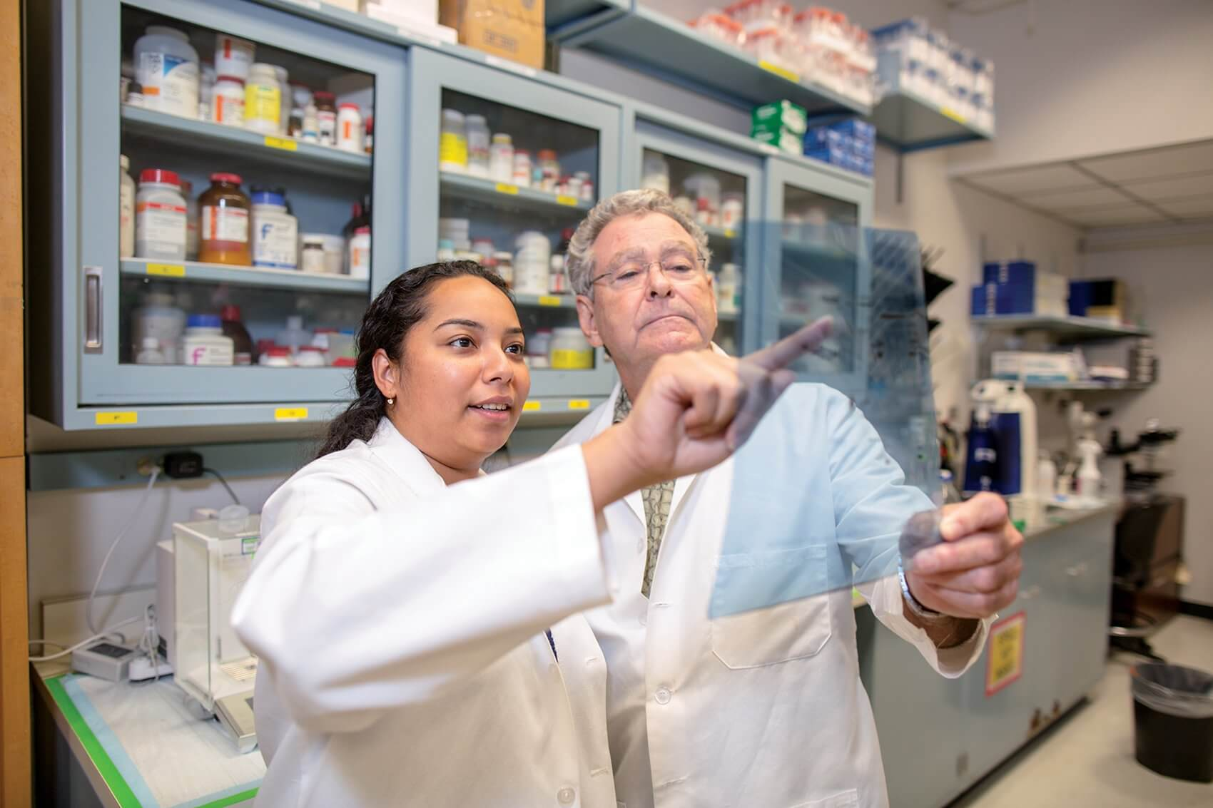 Research Assistant Stephanie Moya and Darrell Carney, UTMB adjunct professor in biochemistry and molecular biology and CEO of Chrysalis BioTherapeutics, Inc.