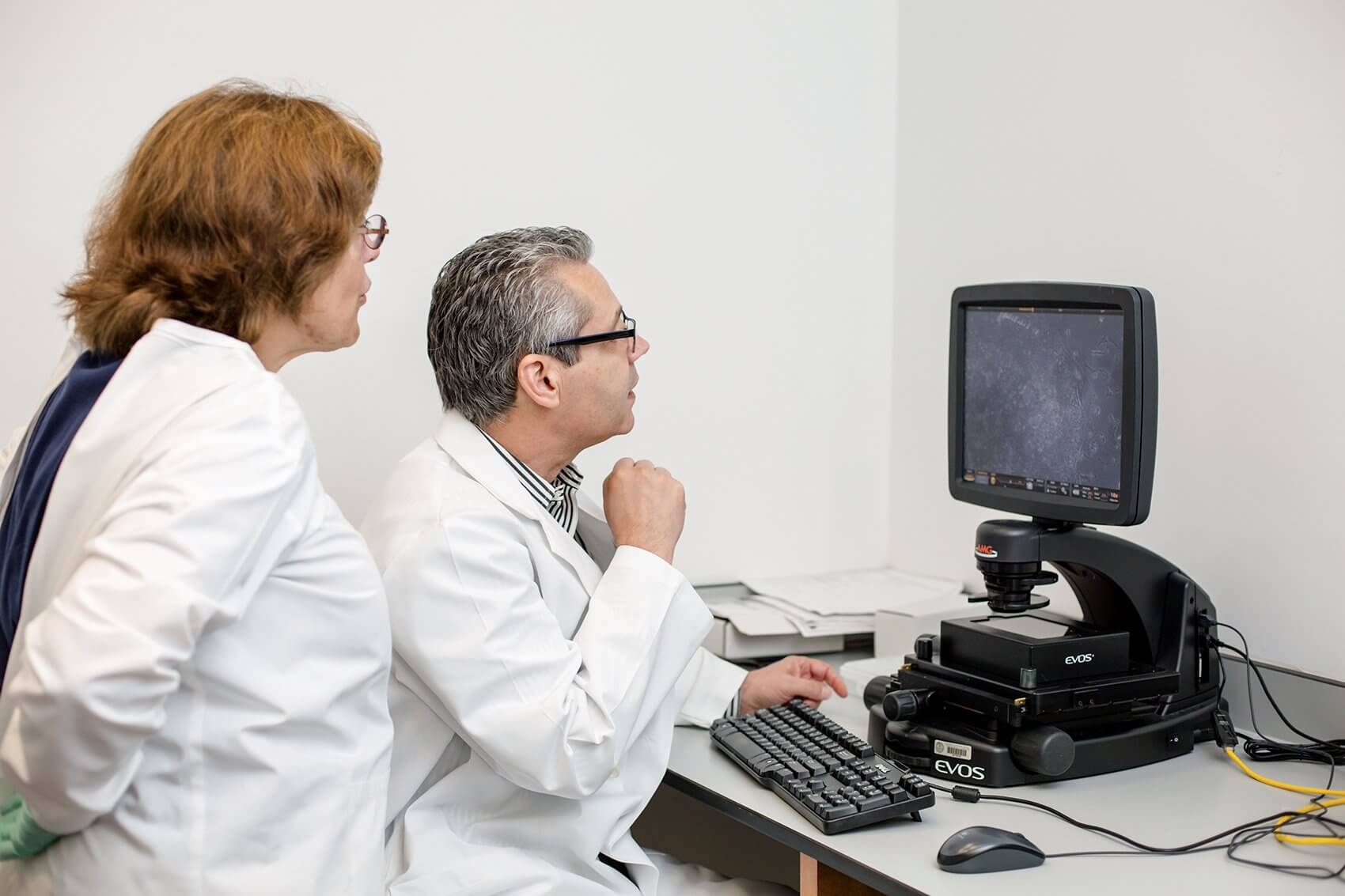 Davis examines induced pluripotent stem cells (iPSCs) from a healthy patient.