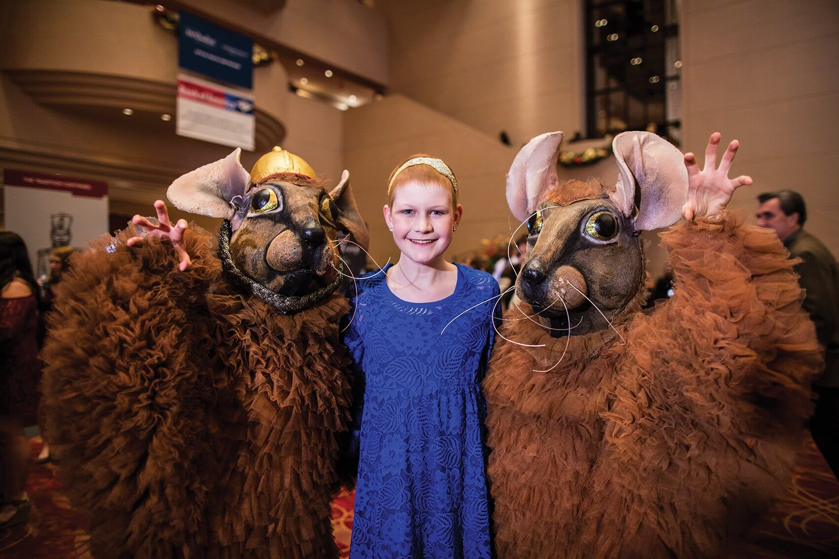 Peyton, pictured with the dancing rats from the Nutcracker, after the Houston Ballet revealed her Rose Parade costume.