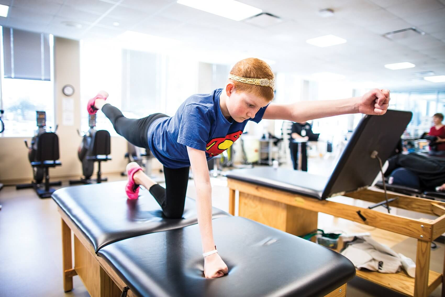 After a severe reaction to methotrexate, Peyton began physical therapy to regain strength and mobility.