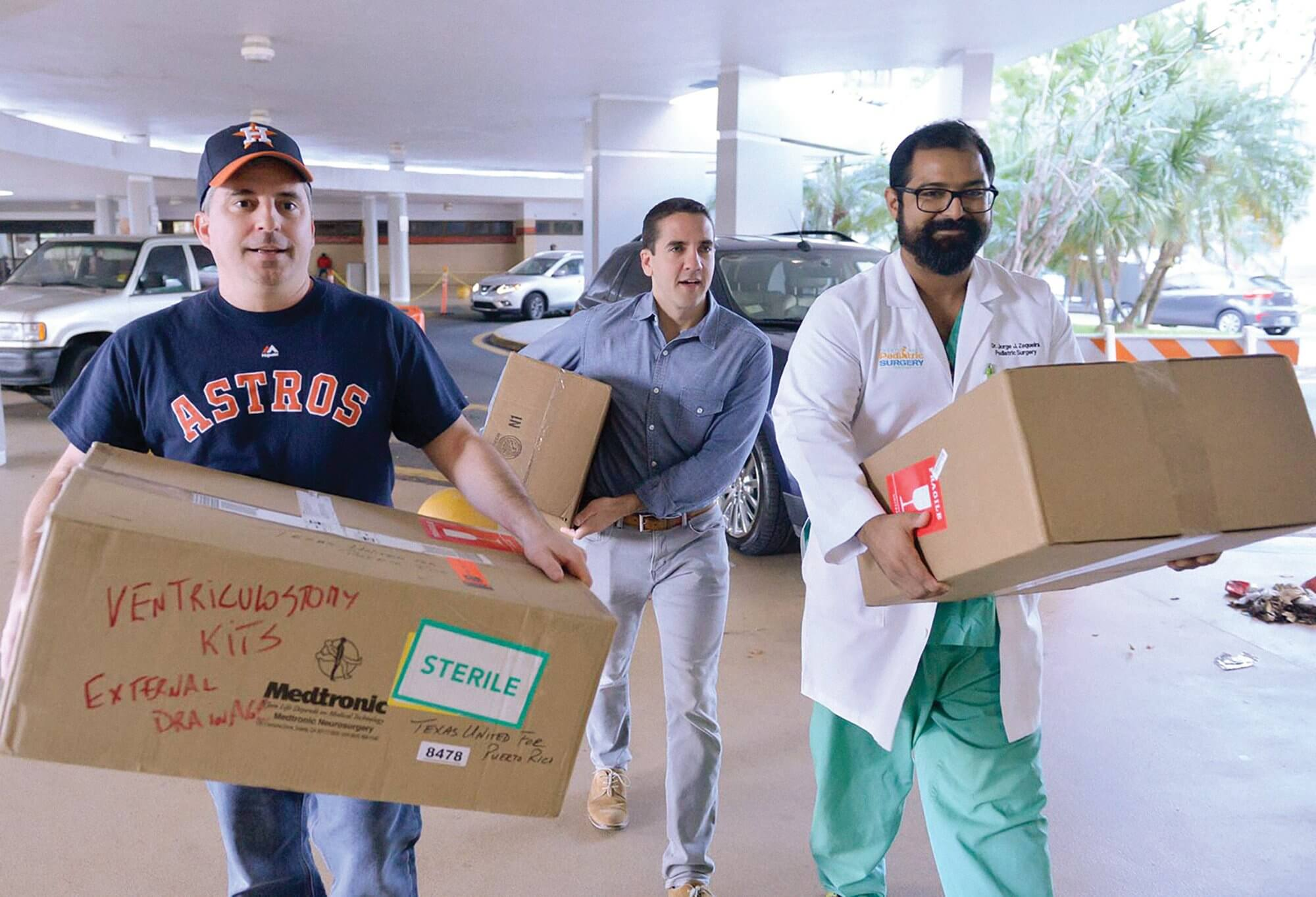 Polo, Flores and a local pediatric surgeon carry donations to The University Pediatric Hospital in San Juan.