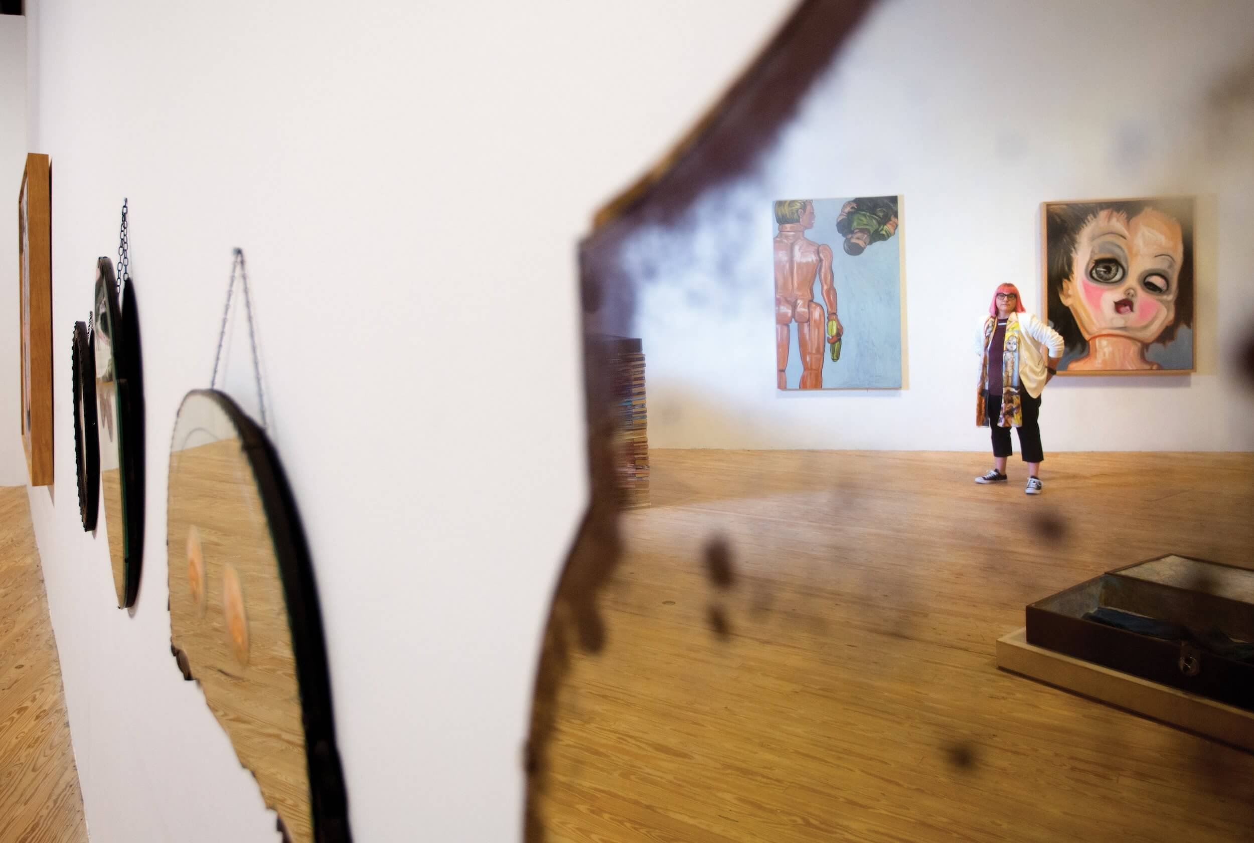 Artist Thedra Cullar-Ledford poses in her exhibit at the Contemporary Arts Museum Houston.