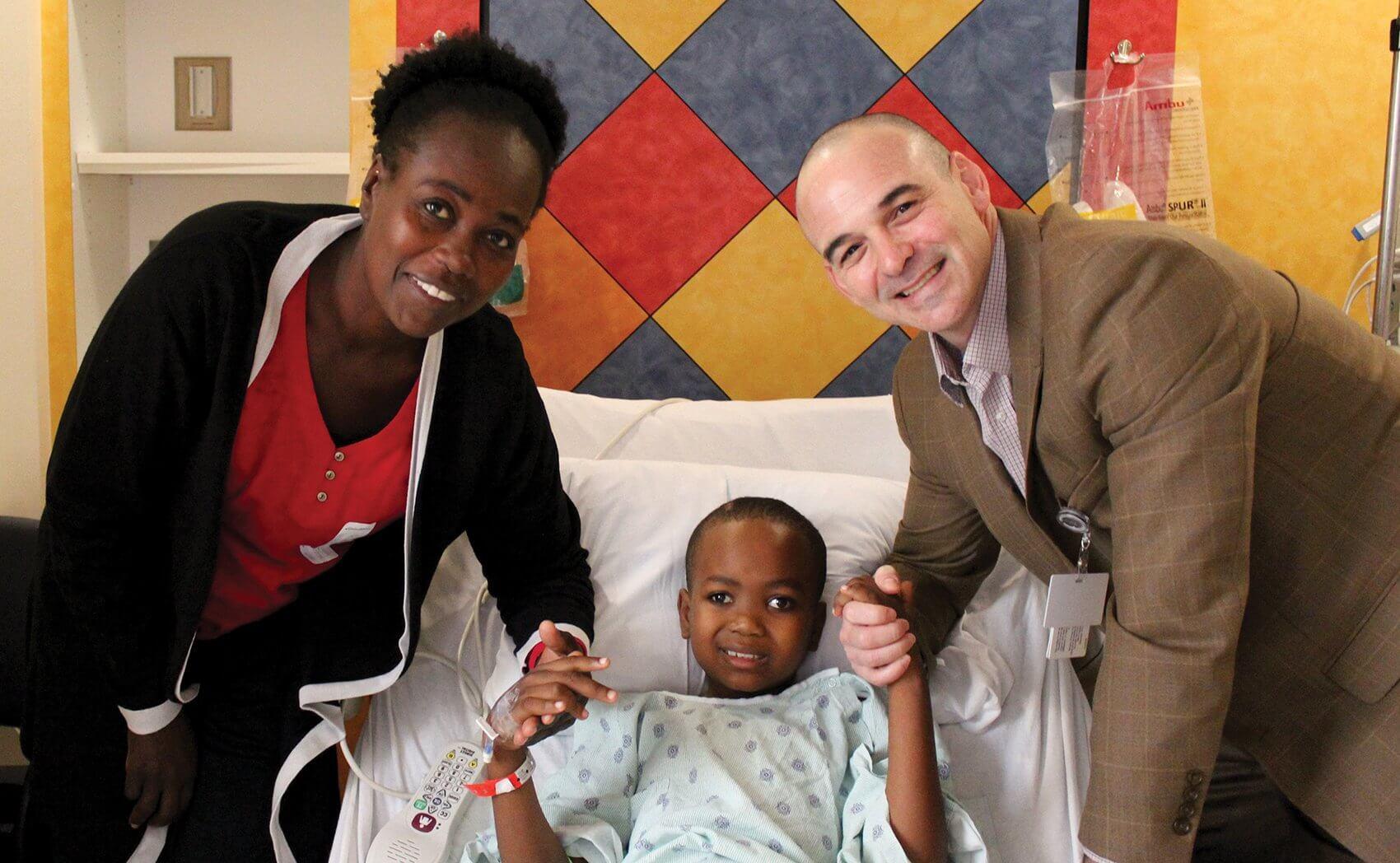 David Sandberg, M.D., with patient Caleb and his mother Bernita. (Credit: Memorial Hermann)