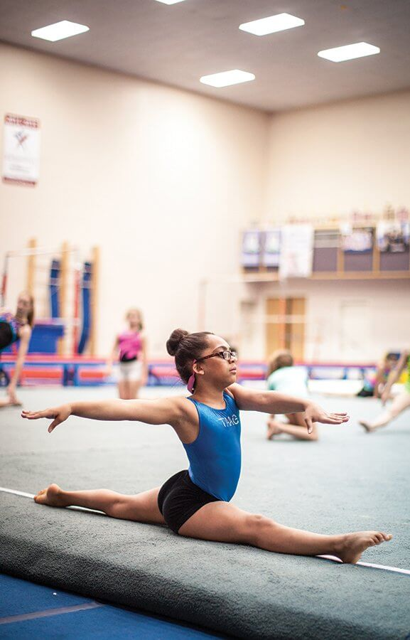 Adrianna, who was diagnosed with congenital glaucoma as an infant, practices gymnastics at the Texas Academy of Acrobatics and Gymnastics.