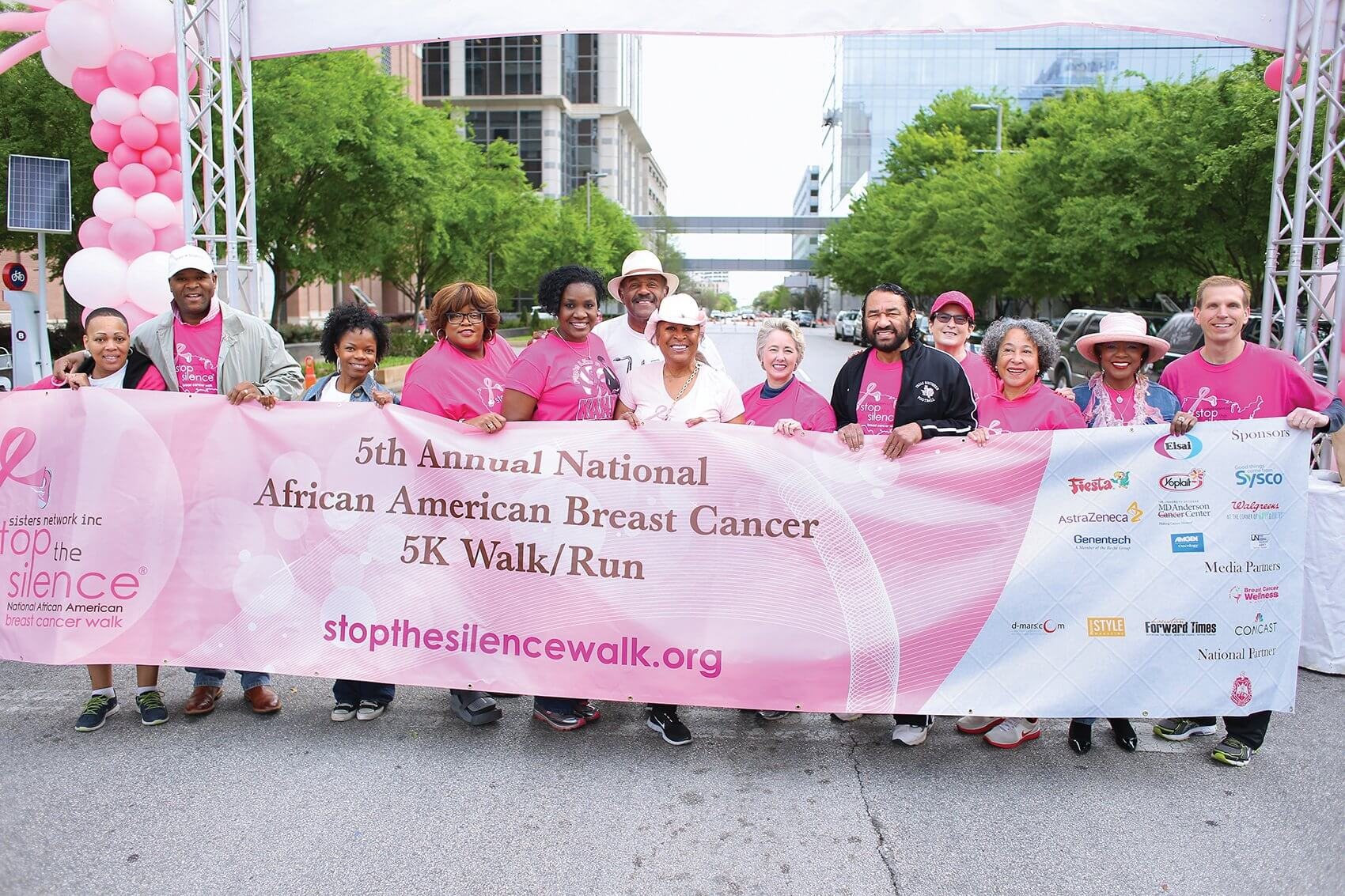 Jackson with Houston Mayor Annise Parker and a group of supporters at the 5th Annual Stop the Silence walk last year. (Credit: Sisters Network Inc.)