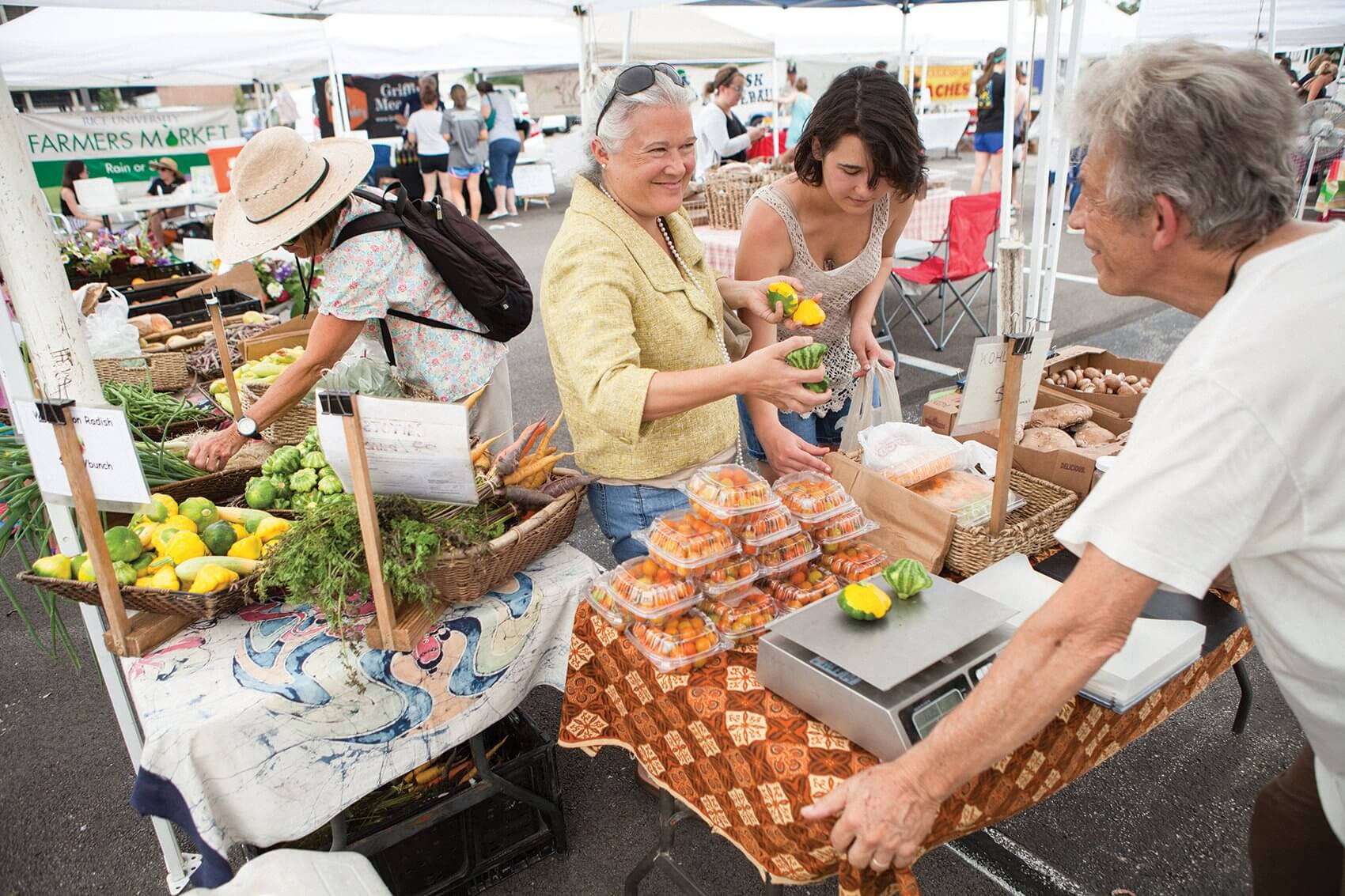 Cas Van Woerden, owner of the certified organic Animal Farm based in Cat Spring, Texas, chats with customers at the Rice University Farmers Market.