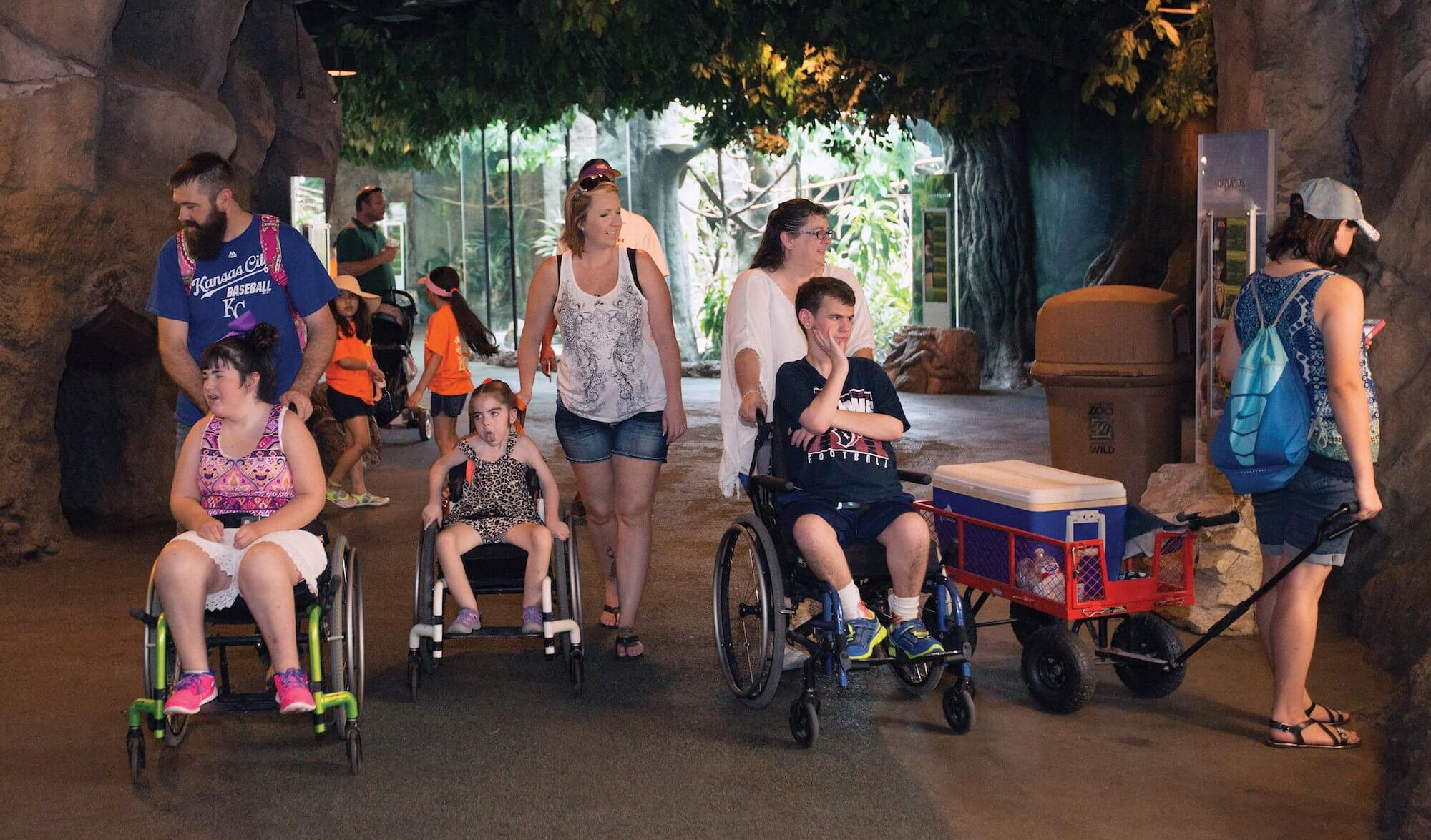 The Mitchell and Hanners families, who connected via Lace Mitchell's Facebook group for individuals affected by Schaaf-Yang Syndrome, enjoy a day together at The Houston Zoo.