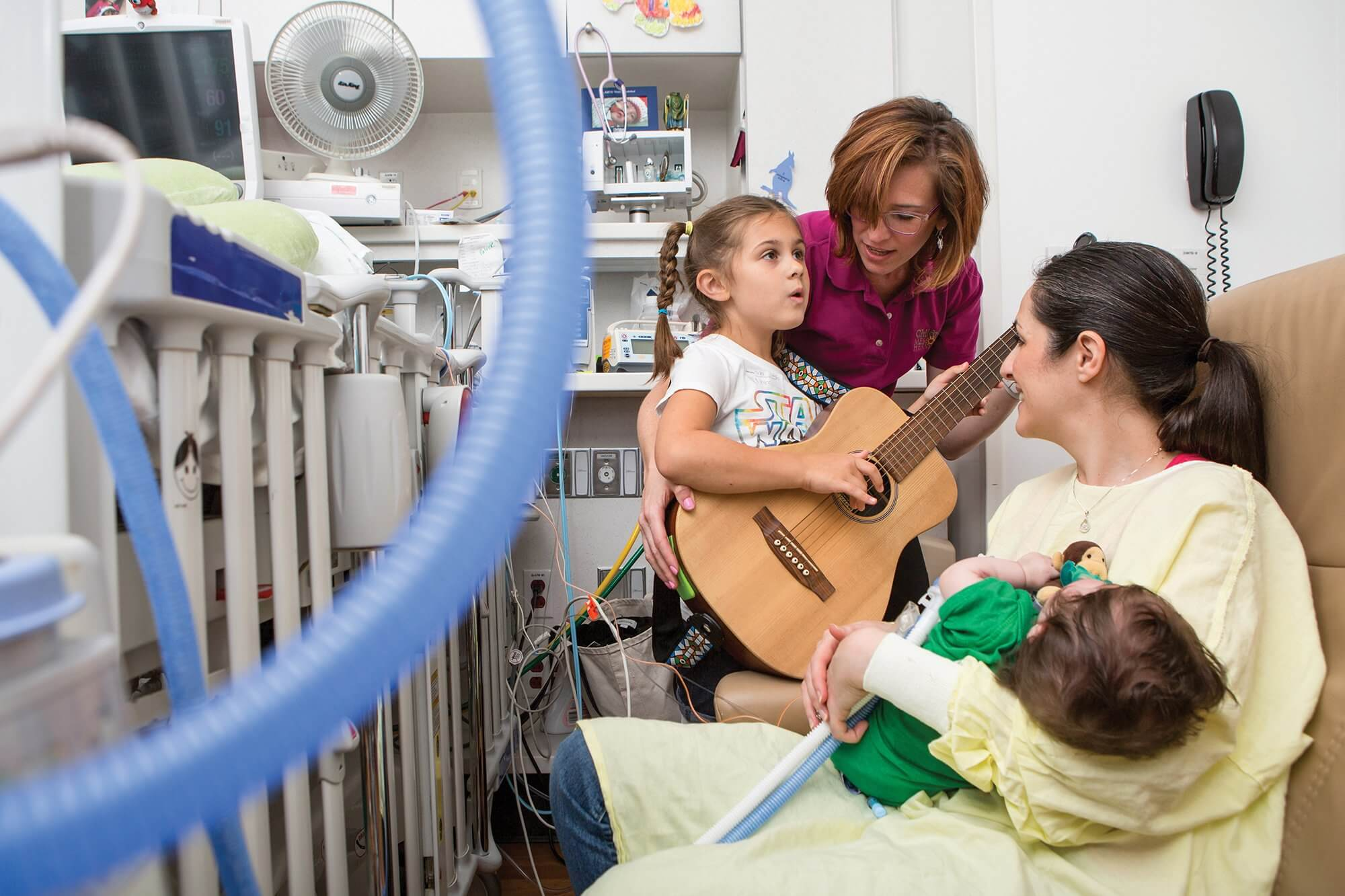 Music therapist Jennifer Townsend and Avery, 6, serenade Avery's mother and brother, Patrick.