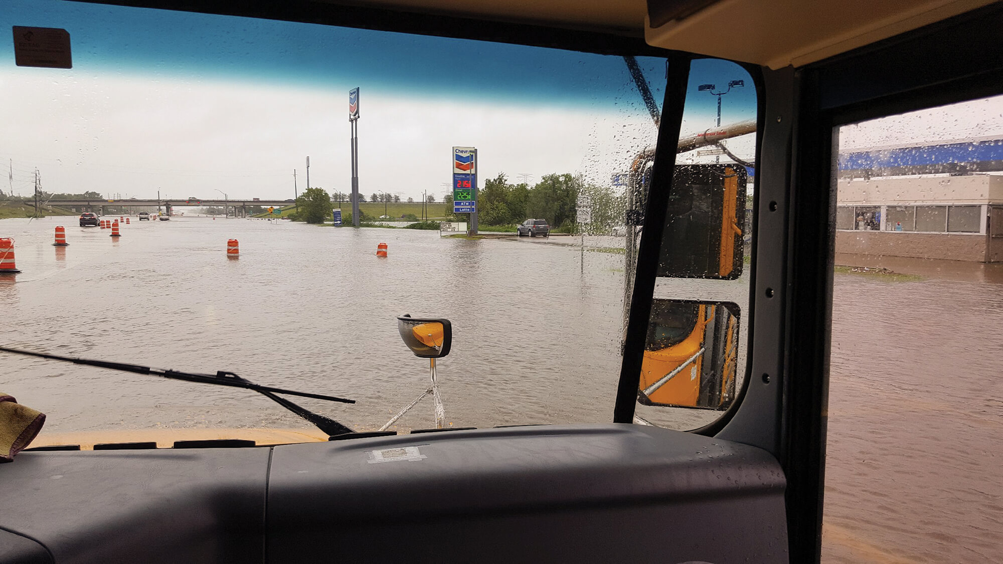Riding a school bus to a nearby shelter, the family encountered high water at Highway 6 and State Highway 288.