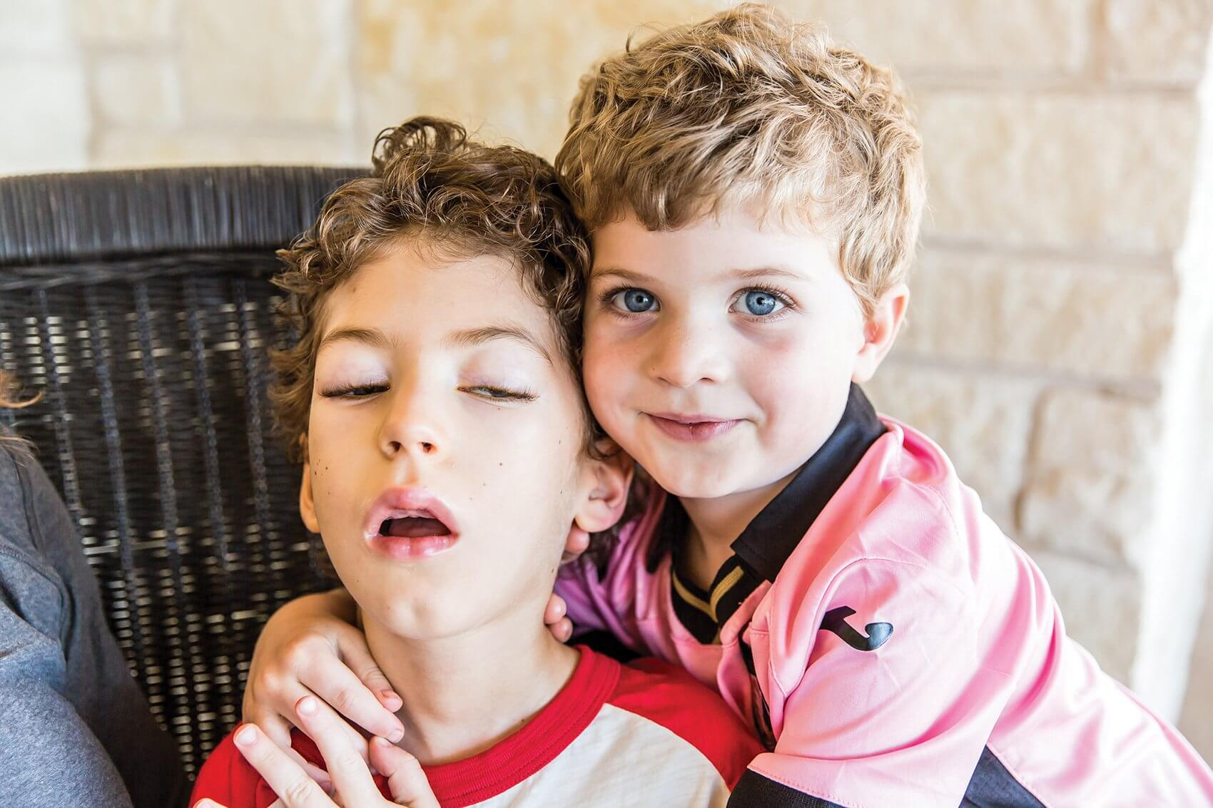 Jacob, left, is a patient at Texas Children's Hospital and Baylor College of Medicine. (Credit: Robbyn Dodd)