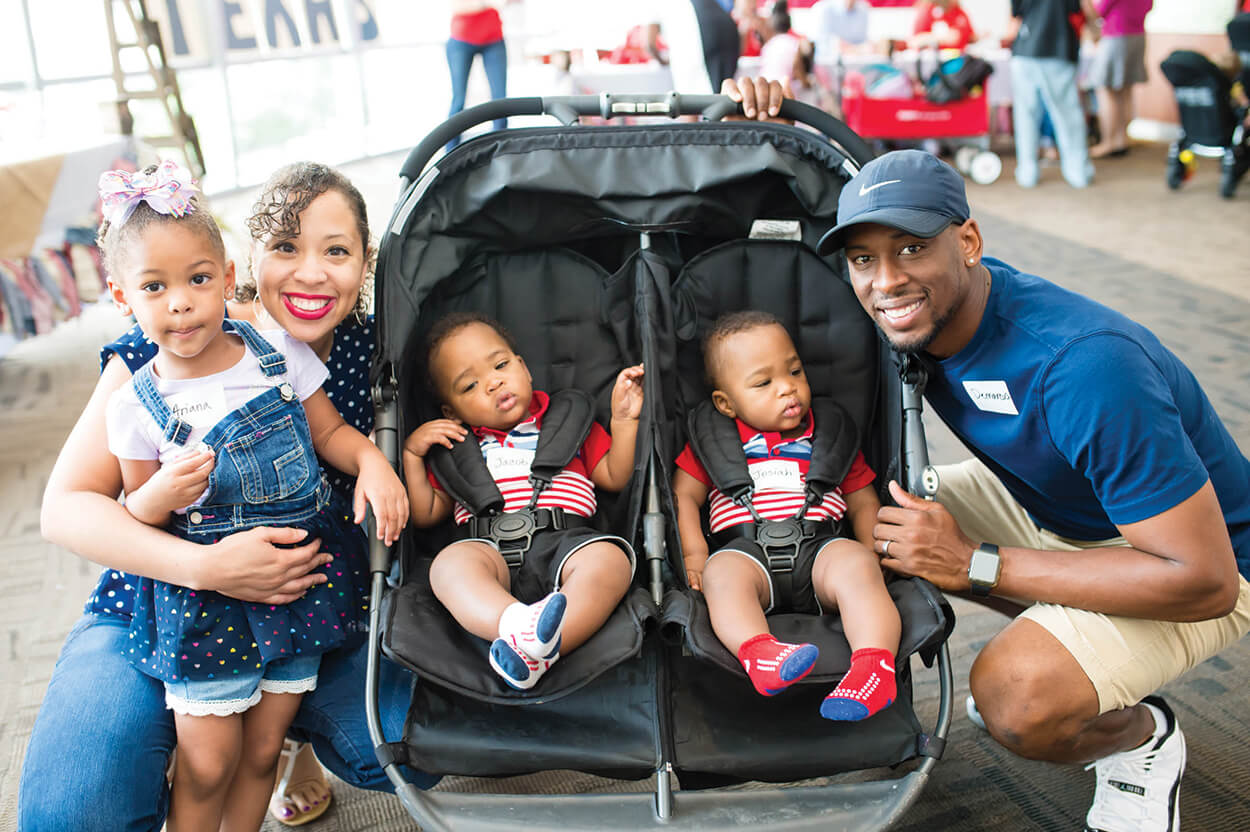 "DEMARCUS AND SADÉ KELLY, with their children Ariana, Jacob and Hosiah, were among the families who attended a ""Made in Texas"" themed neonatal intensive care unit (NICU) reunion on Aug. 4, where they were reunited with TEXAS CHILDREN'S HOSPITAL doctors, nurses and other staff who cared for them. The reunion celebrated former patients who graduated from the Newborn Center in 2017 (Credit: CJ Martin)."