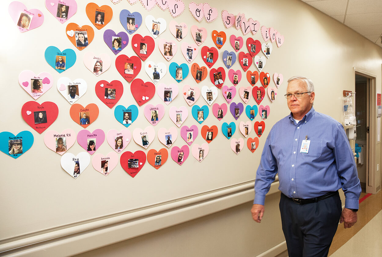 Randy Creech, walking a hallway at Memorial Hermann-Texas Medical Center, has been living with a donor heart for nearly three decades.