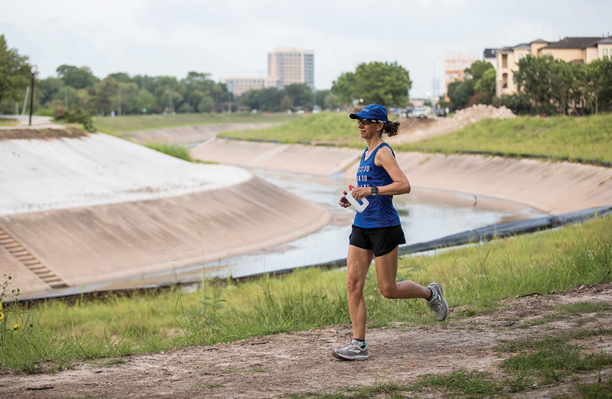 Richards-Kortum jogs along Brays Bayou on a mid-July morning.