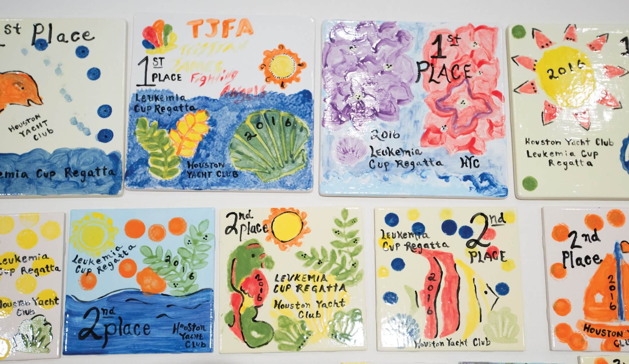 Tiles painted by patients at Texas Children's Hospital are given as trophies to individuals for their fundraising efforts.