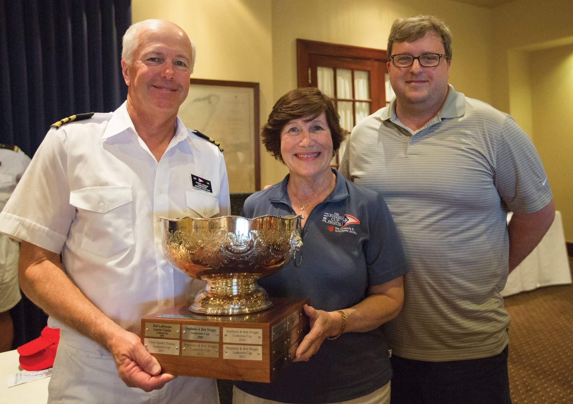Cheryl Thomas, director of the Leukemia Cup Regatta, holds the trophy created in memory of her sister, Claudia Sparks Cannon.