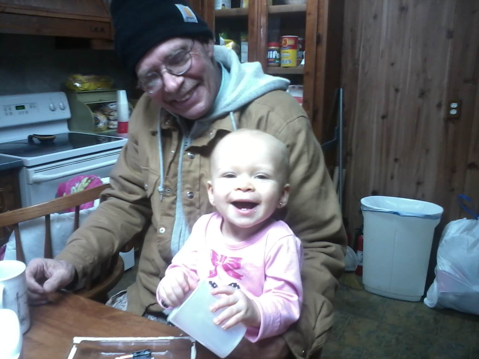 Richard Harveston with his granddaughter following his surgeries.