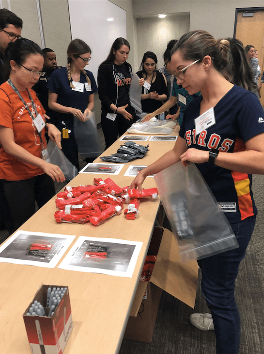 Lauren Leining, an epidemiology student at UTHealth's School of Public Health, packs a 'Stop the Bleed' kit that will be placed in one of the 128 AED boxes on the UTHealth campus.