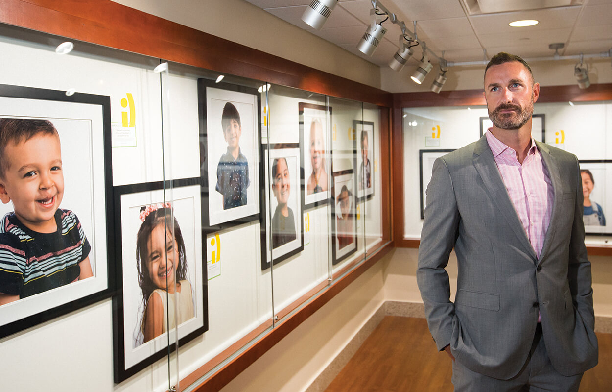 Matthew Greives, M.D., a pediatric plastic surgeon at Children's Memorial Hermann, stands inside the exhibit.