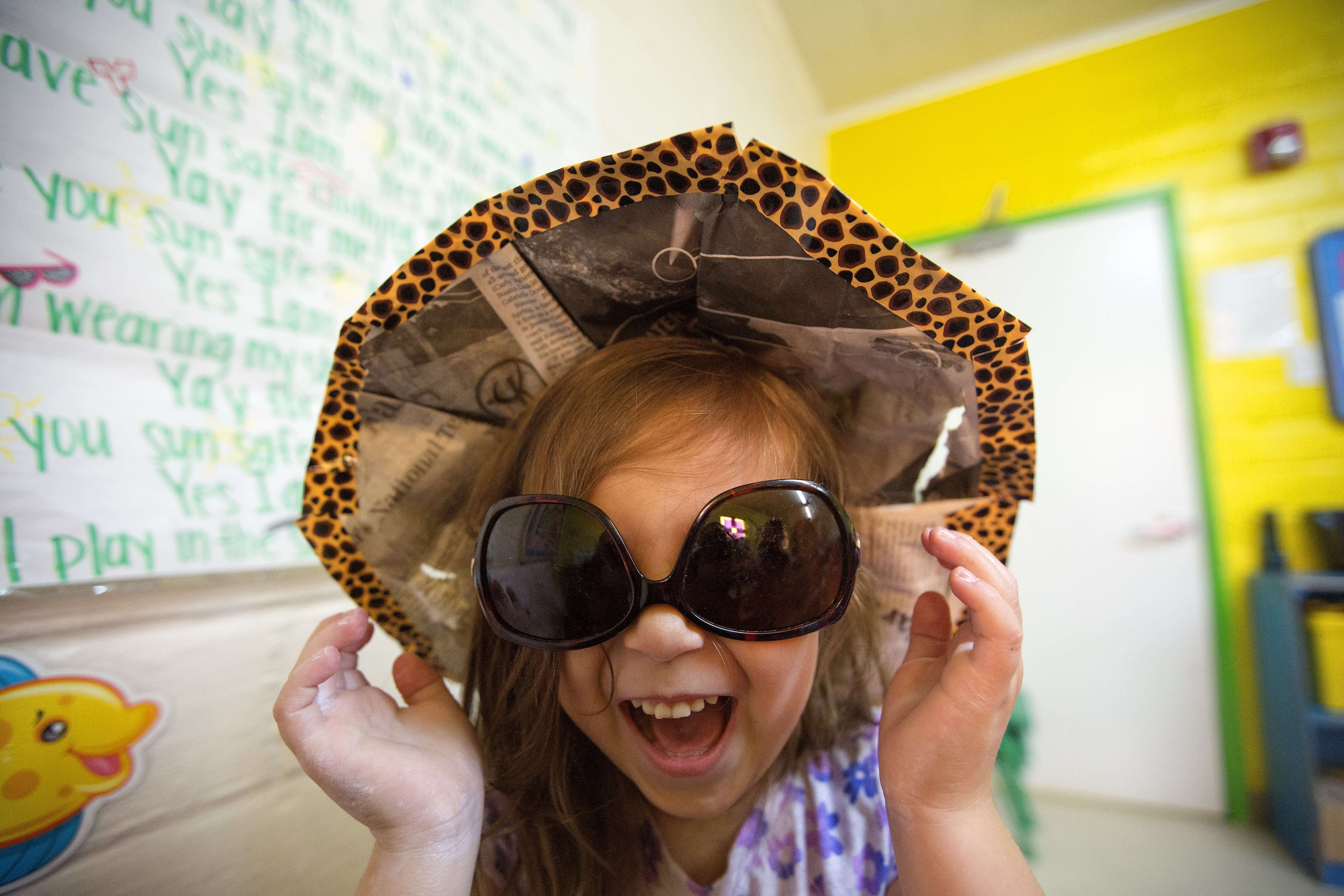 The Ray and the Sunbeatables curriculum teaches children that wearing sunglasses and hats will protect them from the sun.