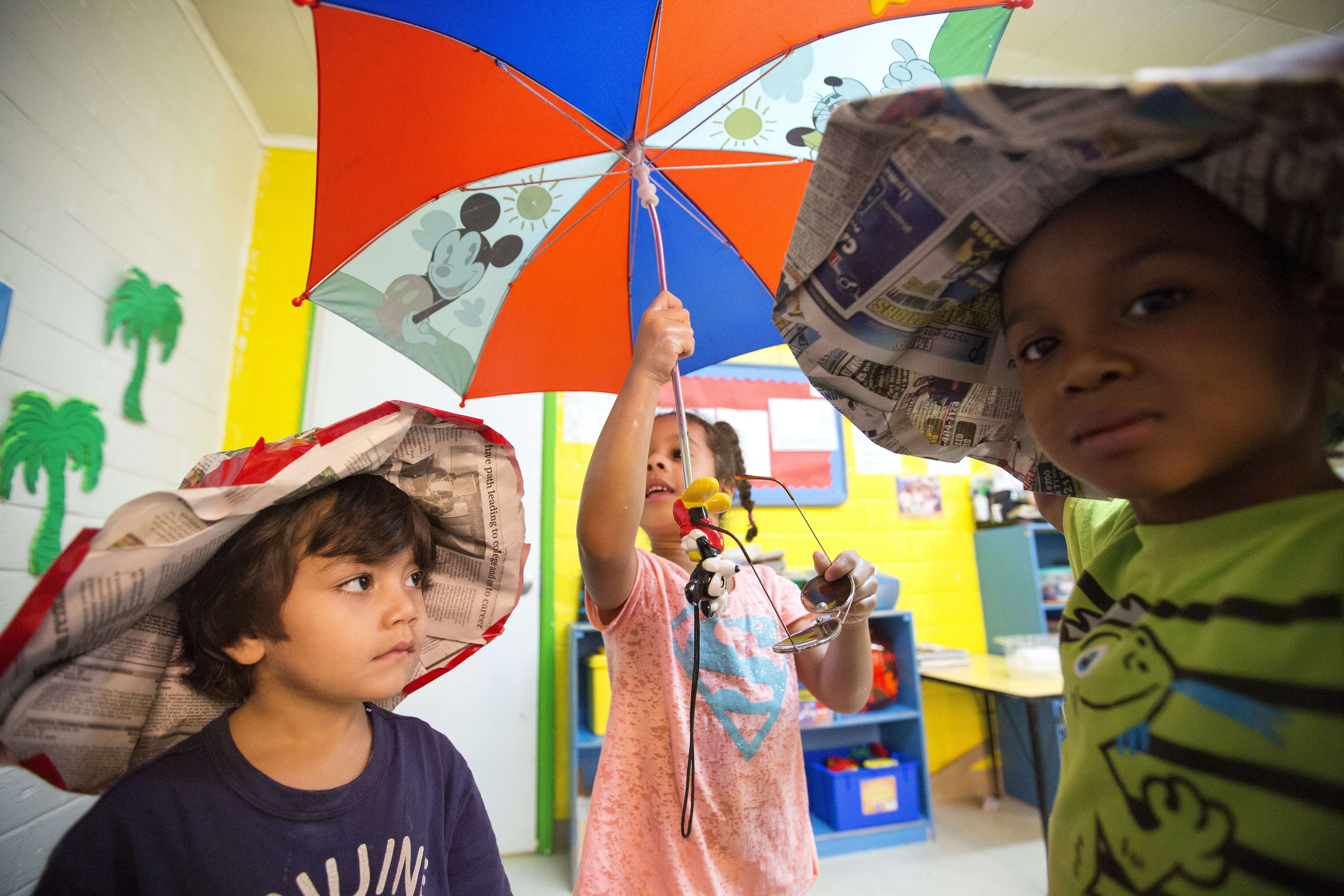 Umbrellas offer good protection from the sun, and they're part of the Ray and the Sunbeatables curriculum.