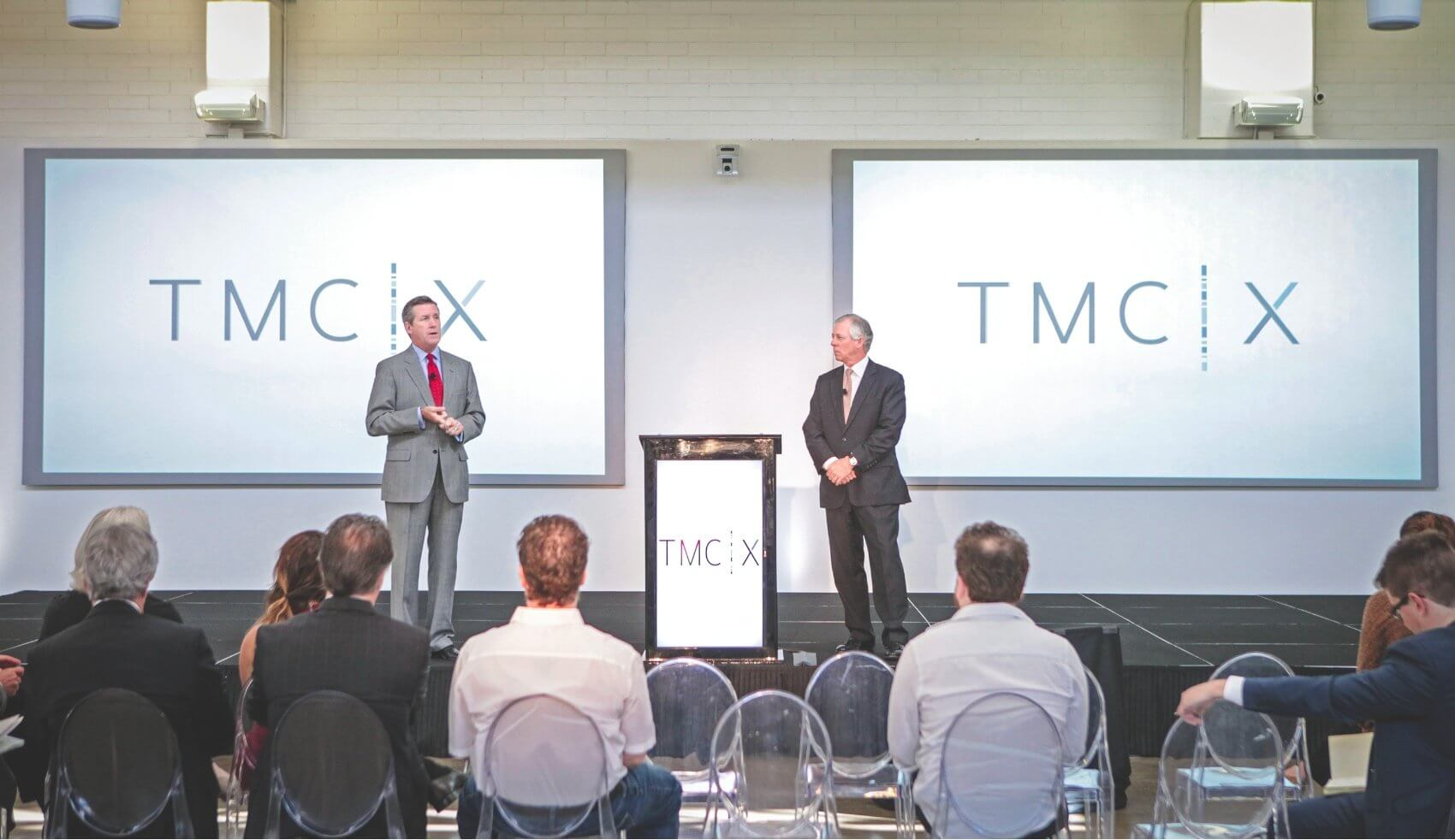 Texas Medical Center Chief Executive Officer and President Robert C. Robbins, M.D., and Chief Strategy and Operating Officer and Executive Vice President William F. McKeon speak to visitors during the grand opening of the TMCx.