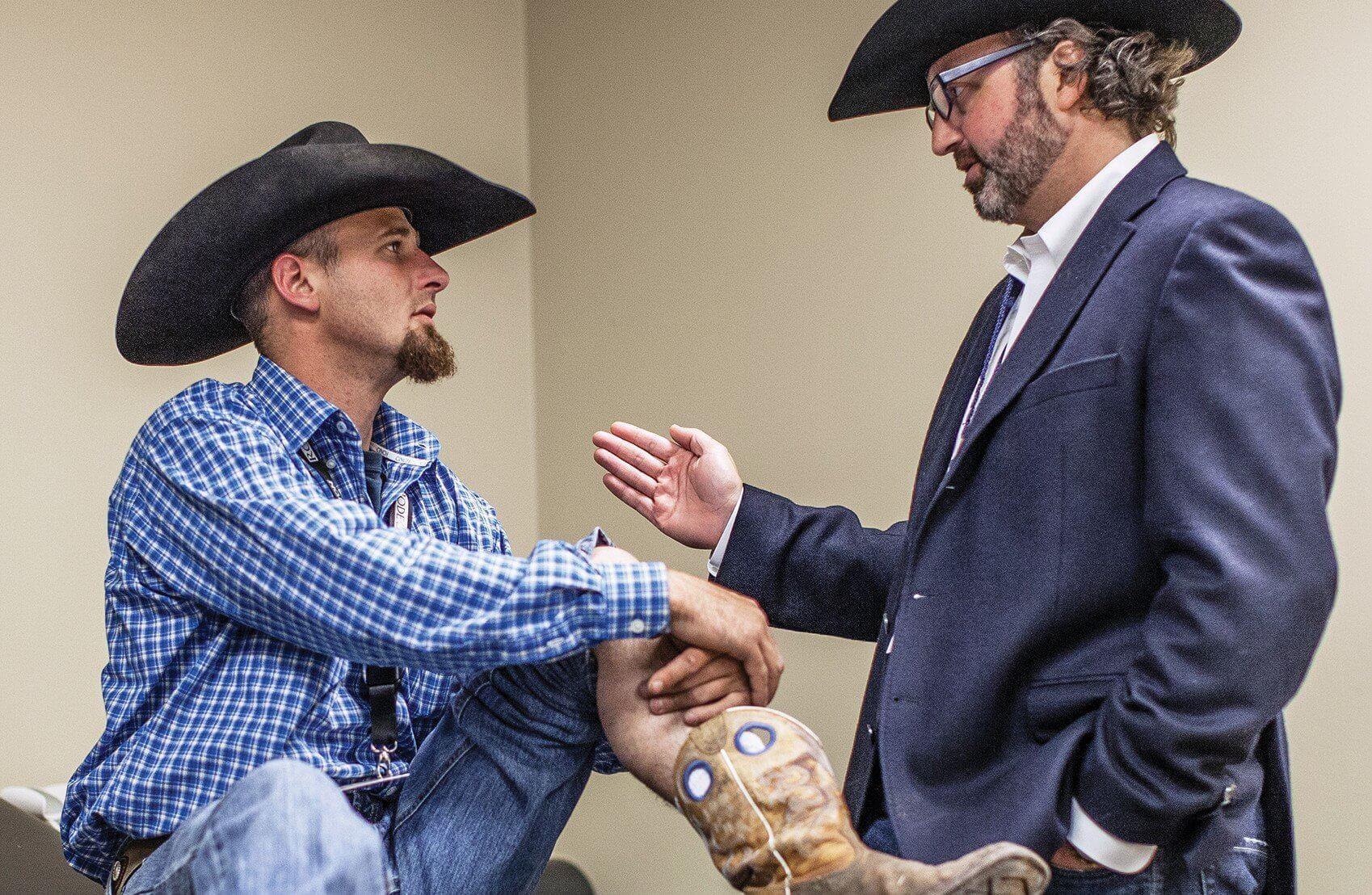 Stripping chute worker Michael Ondrusek, left, consults Patrick McCulloch, M.D., a Houston Methodist orthopedic surgeon.