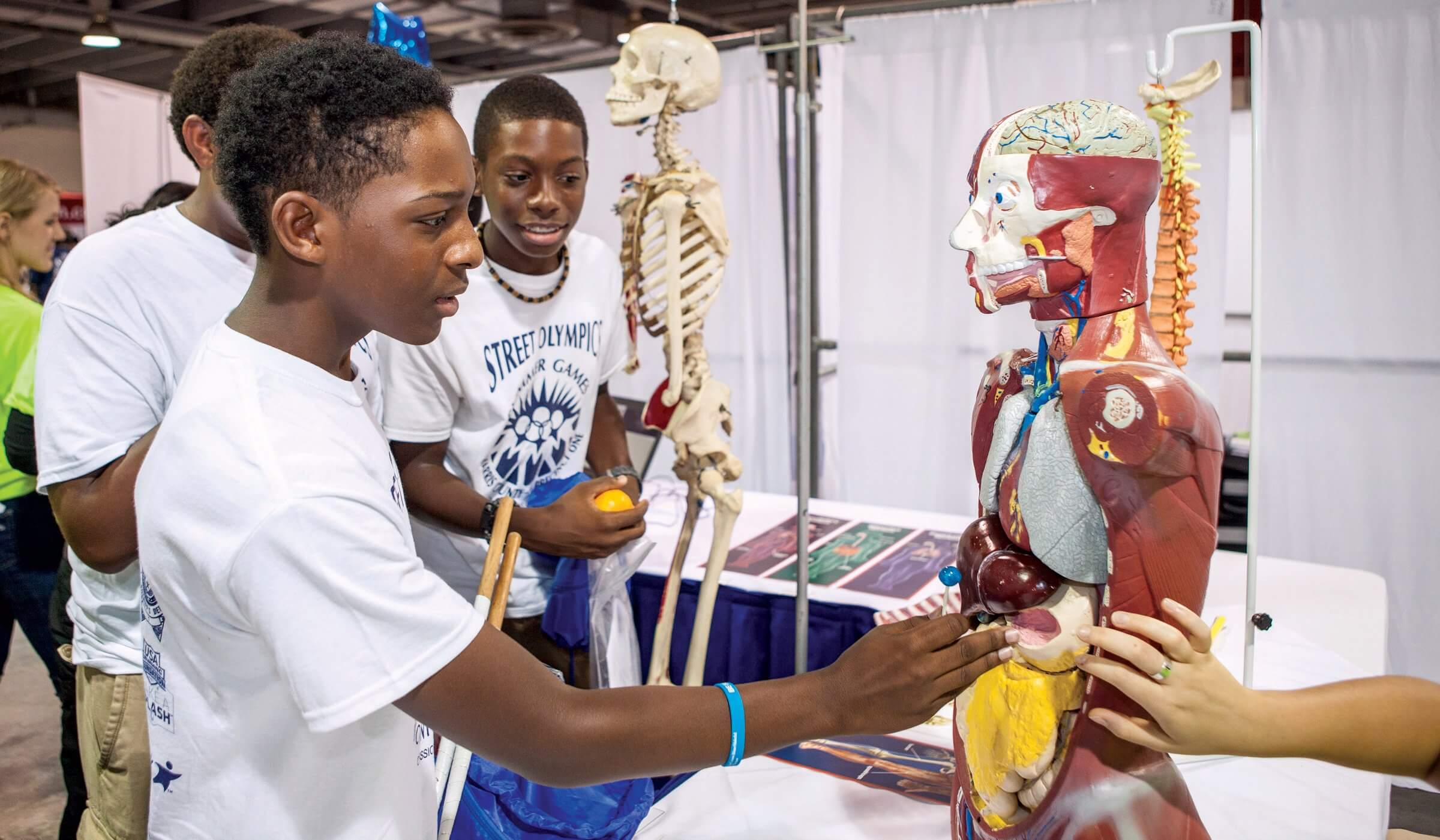 At the booth for the Texas Medical Center, athletes are able to interact with a display that demonstrates different parts of the human anatomy.