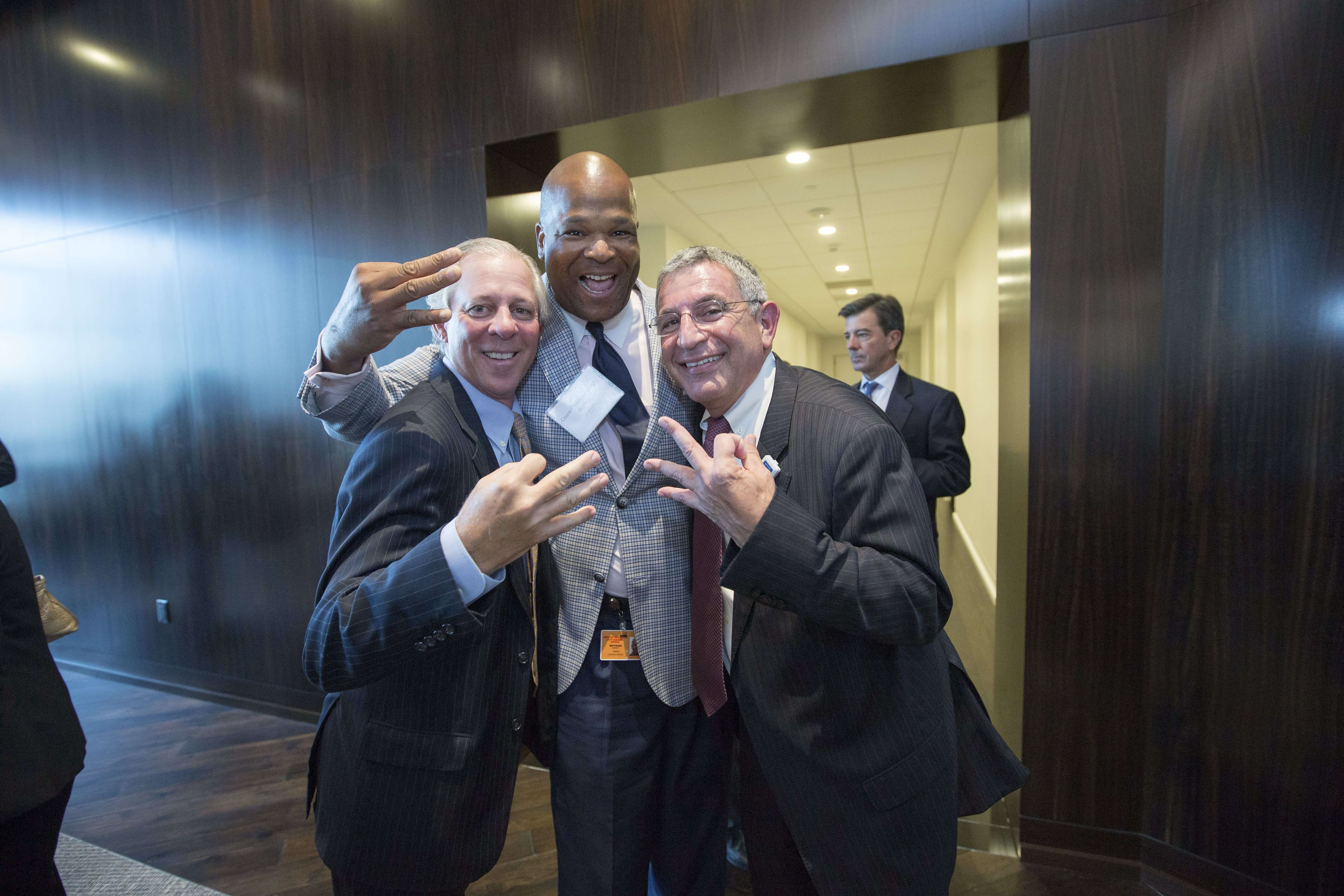 Robbert C. Robbins, M.D., Texas Medical Center CEO and president, Dwight Boykins, Council Member and Paul Klotman, M.D., president, CEO and executive dean of Baylor College of Medicine, throw up a three for the Third Coast.