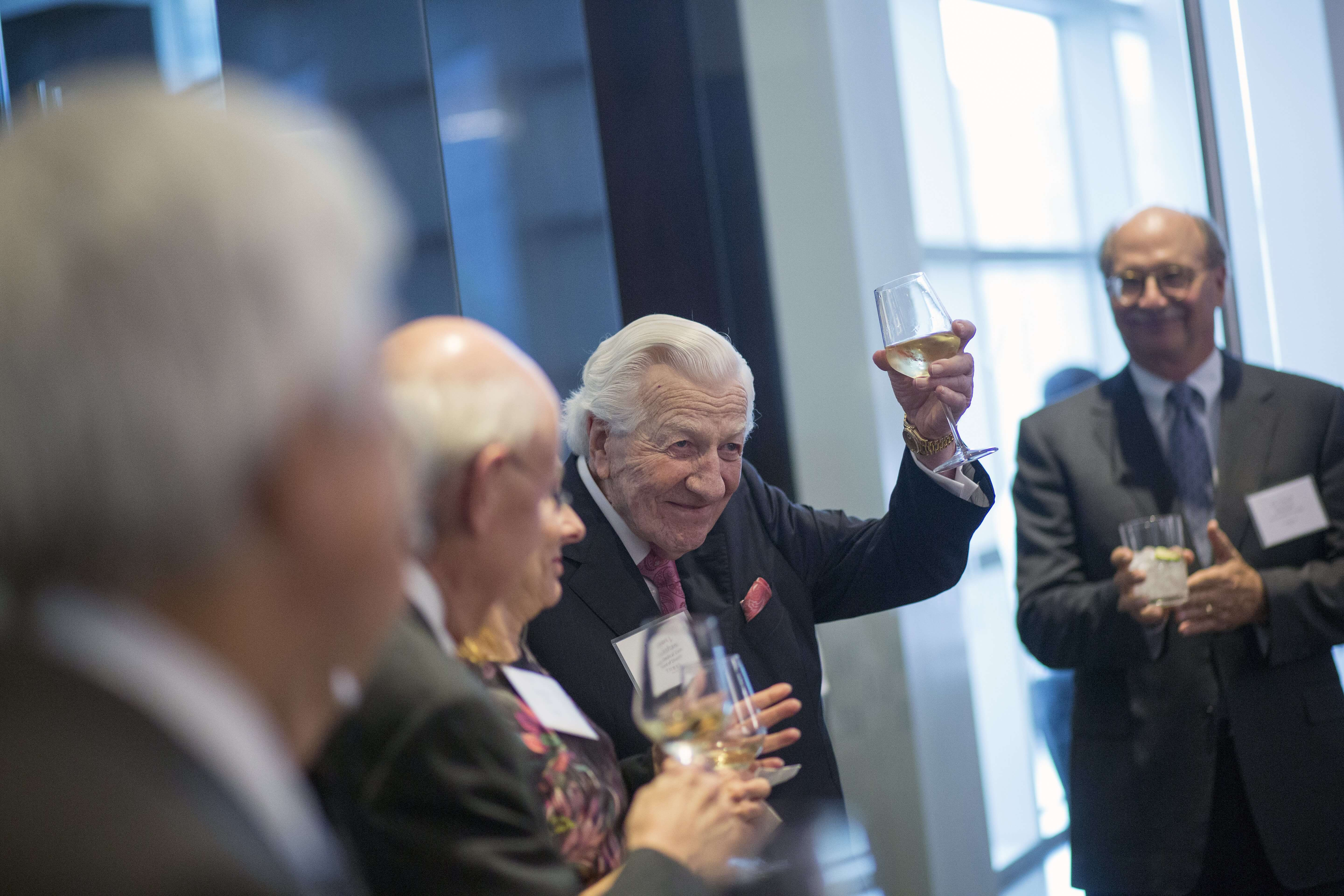 Texas Medical Center Board Member, Robert Cruikshank, toasts guests as he is introduced for the evening.
