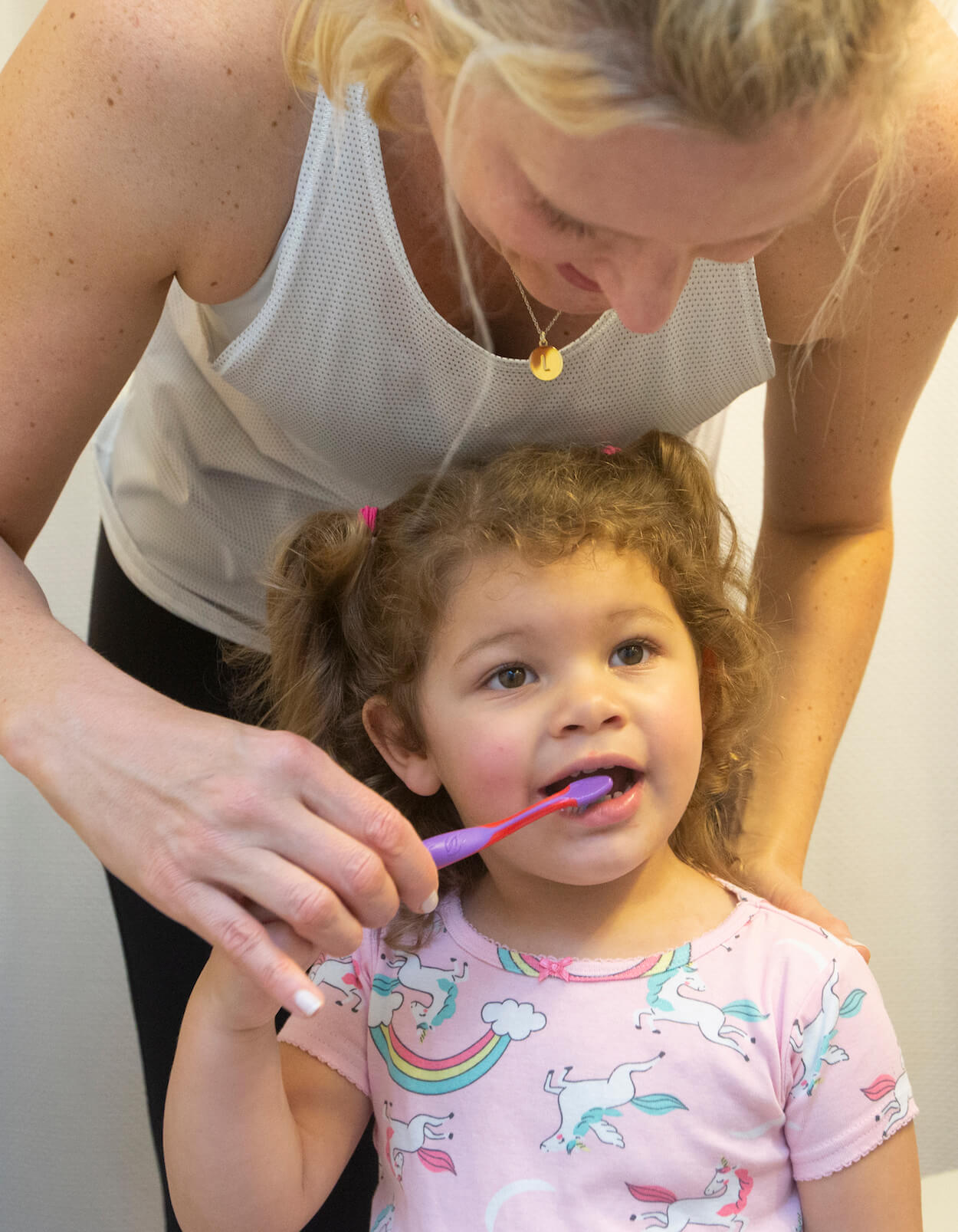 Shannon Alfonso helps her 2-year-old daughter, Lizzie, brush her teeth twice a day.