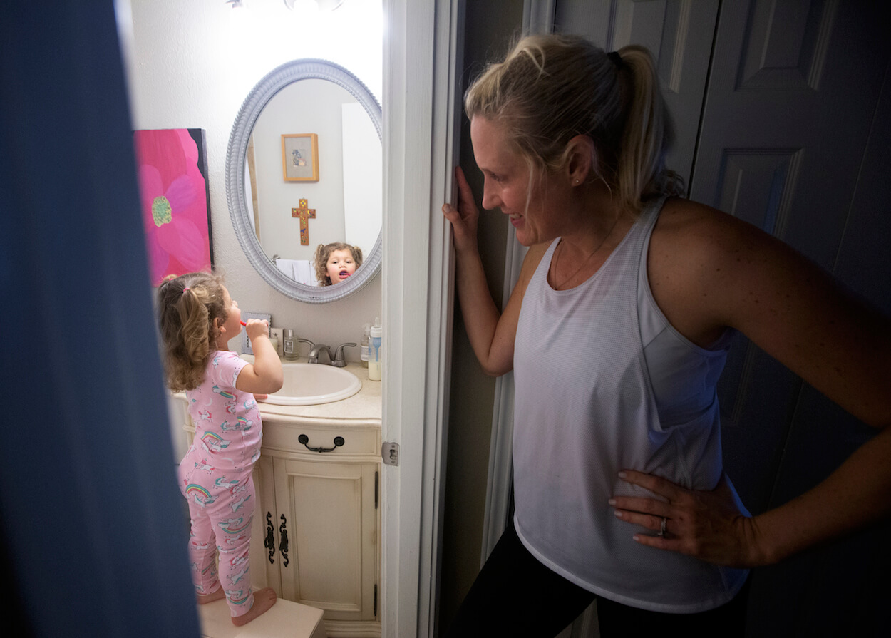 Lizzie, 2, is very independent, but her mother, Shannon Alfonso, keeps a watchful eye as she brushes her teeth.