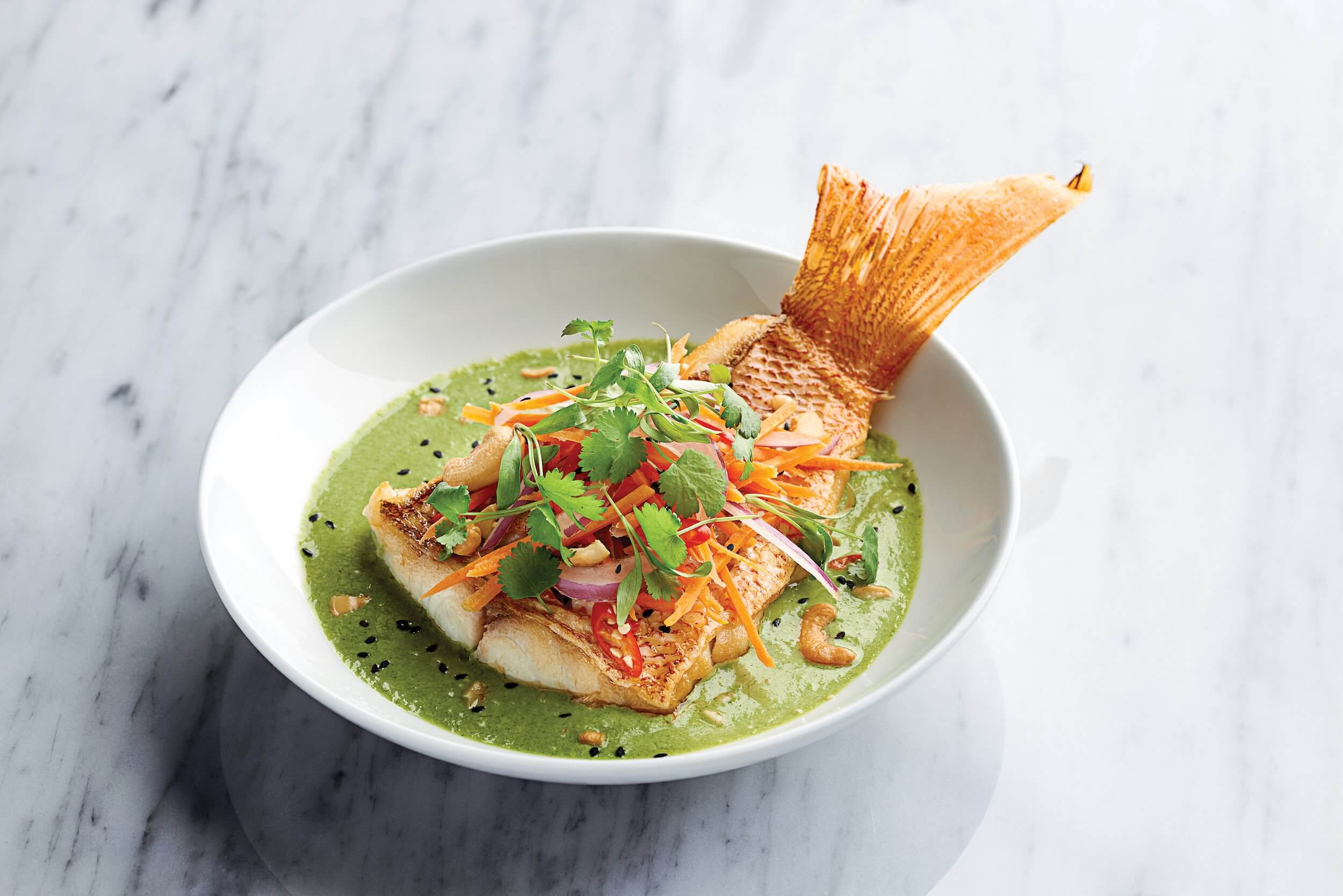 Red Snapper with green curry, vegetable slaw, cashews and lemongrass-ginger rice.