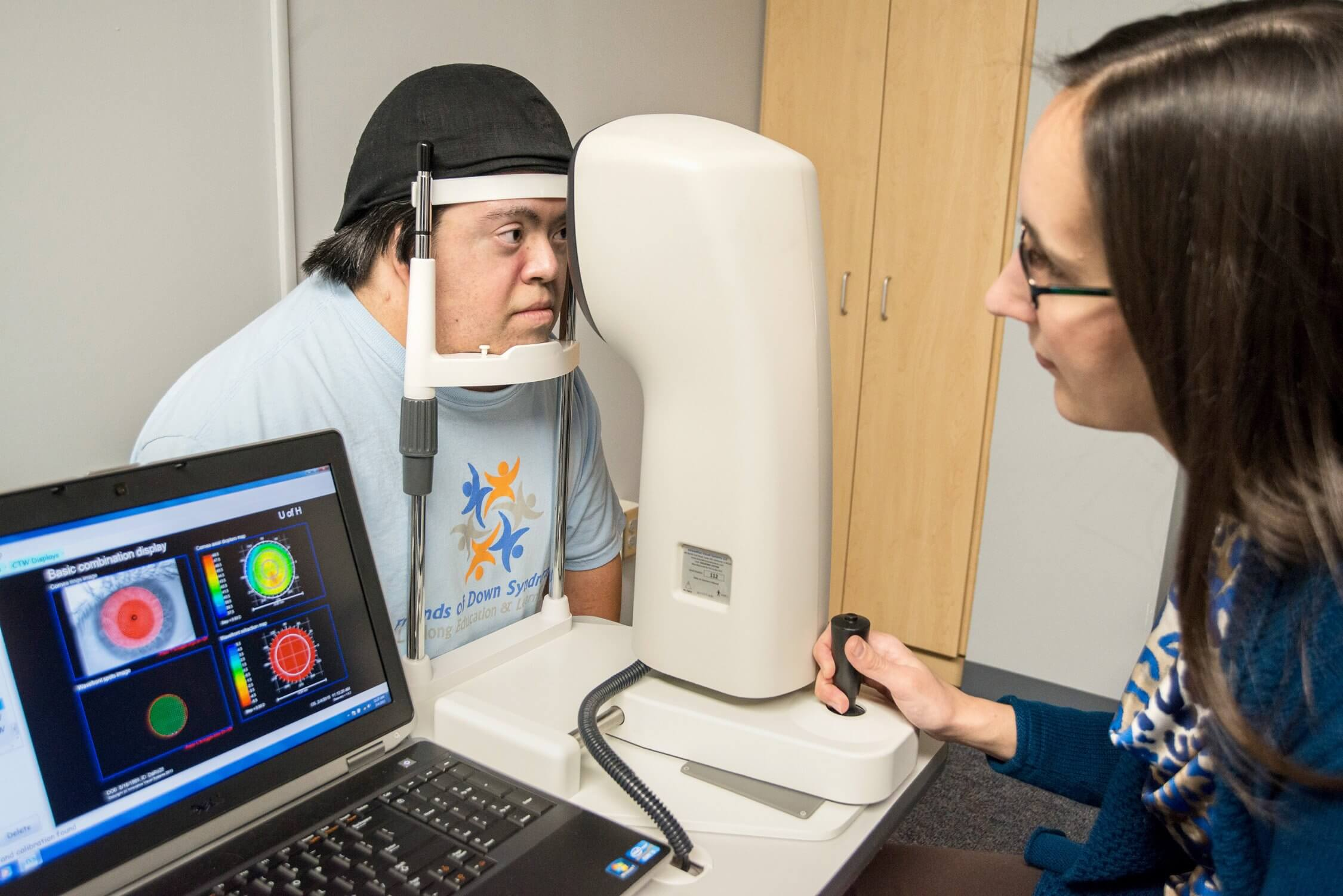 Heather Anderson, an optometrist and assistant professor with the University of Houston, examines a patient's eyes. (Credit: David Gee)