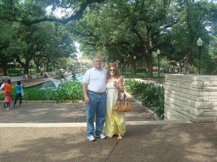 Hughes wears surgical drain tubes under her dress during a visit to the zoo with her father. After she had a total of 14 melanomas removed, she returned to Alabama for physical therapy and was required to wear drain tubes for six to eight weeks to flush out fluids from the surgical sites. (Photo credit: Sarah Hughes)