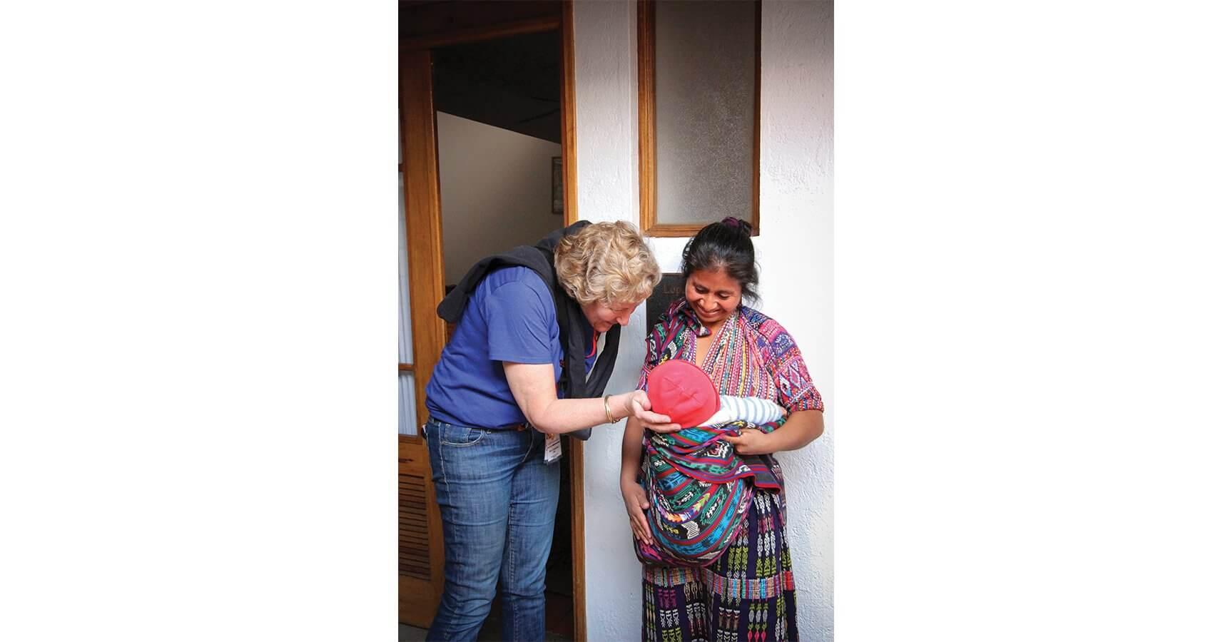 Pam Gallacher greets patients at Casa de Fe, Faith in Practice's 100-bed patient facility. (Credit: Josie Johnson)