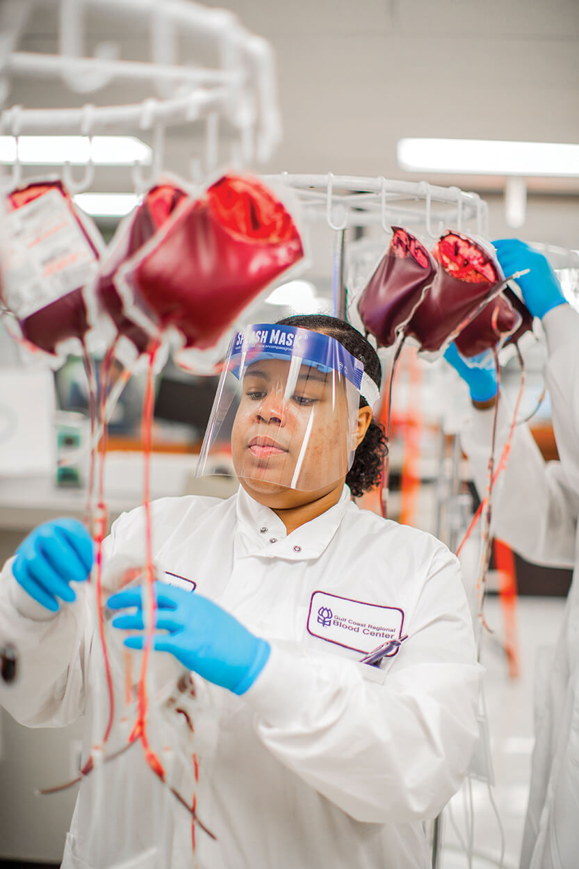 Component lab technician Elizabeth Scott processes blood donations for components separation at the Gulf Coast Regional Blood Center.