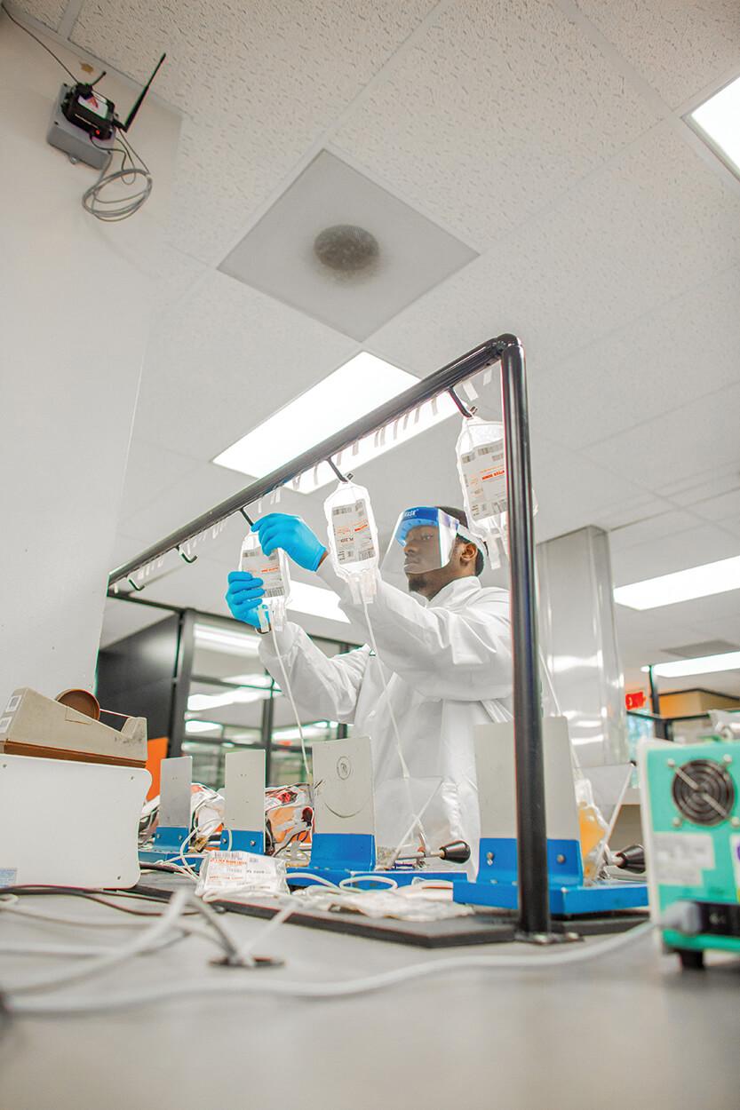Component lab technician Jamaal Jones prepares blood product bags at Gulf Coast Regional Blood Center.