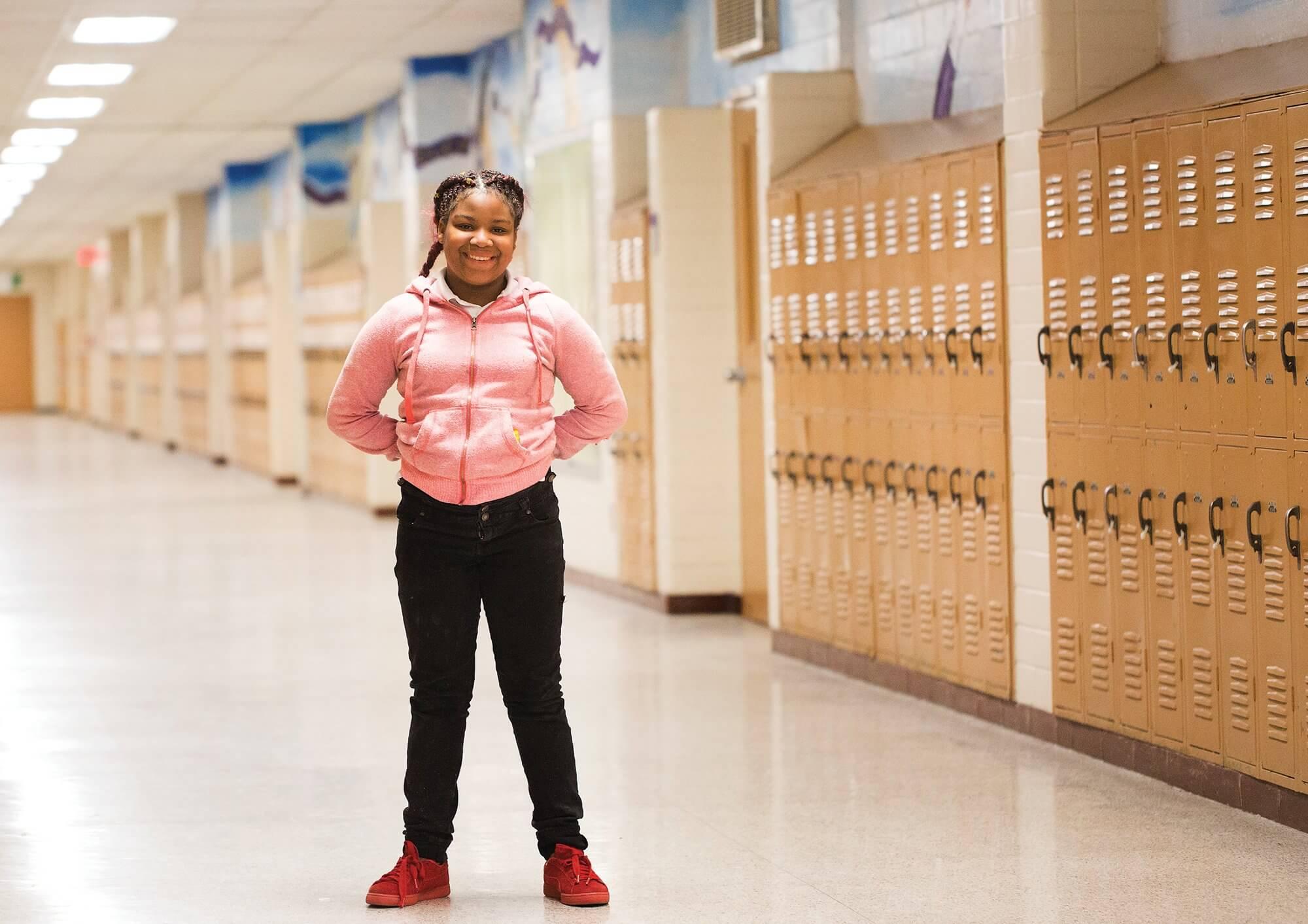 Kenya, 12, in the hallway of her school.
