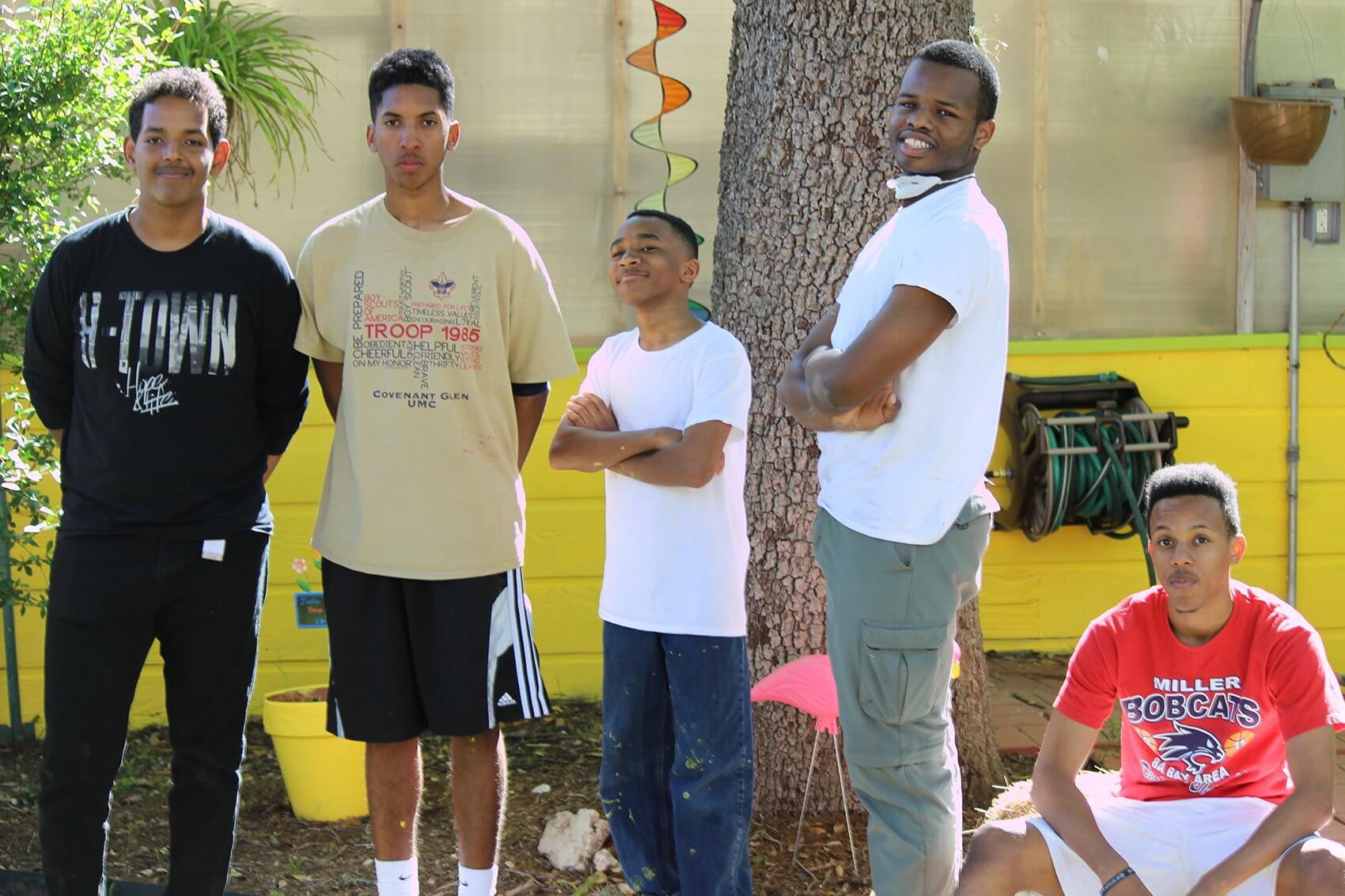 From left to right: Caleb Tewolde, Eagle Scout candidate Justin Campbell, Shannon Norwood, Malik Wright and Philip Prater take a break from cleaning up and painting the greenhouse at TIRR Memorial Hermann.