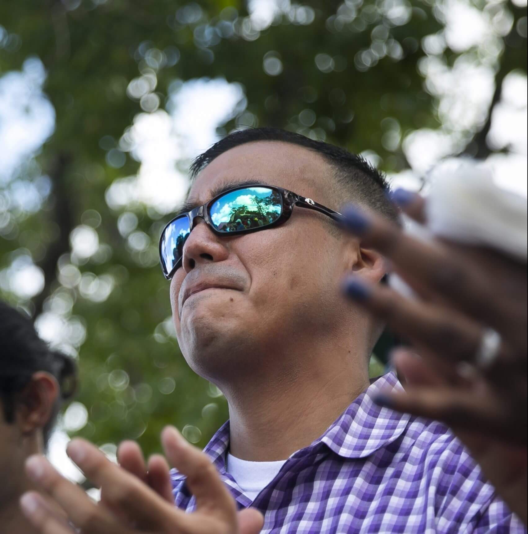 Emilio Hererra III, LMSW, claps while veterans are pinned by Congresswoman Sheila Jackson Lee during Houston Stand Down on Oct. 5, 2018. Herrera, who works with the Health Care for Homeless Veterans program, was one of the organizers of the annual event.